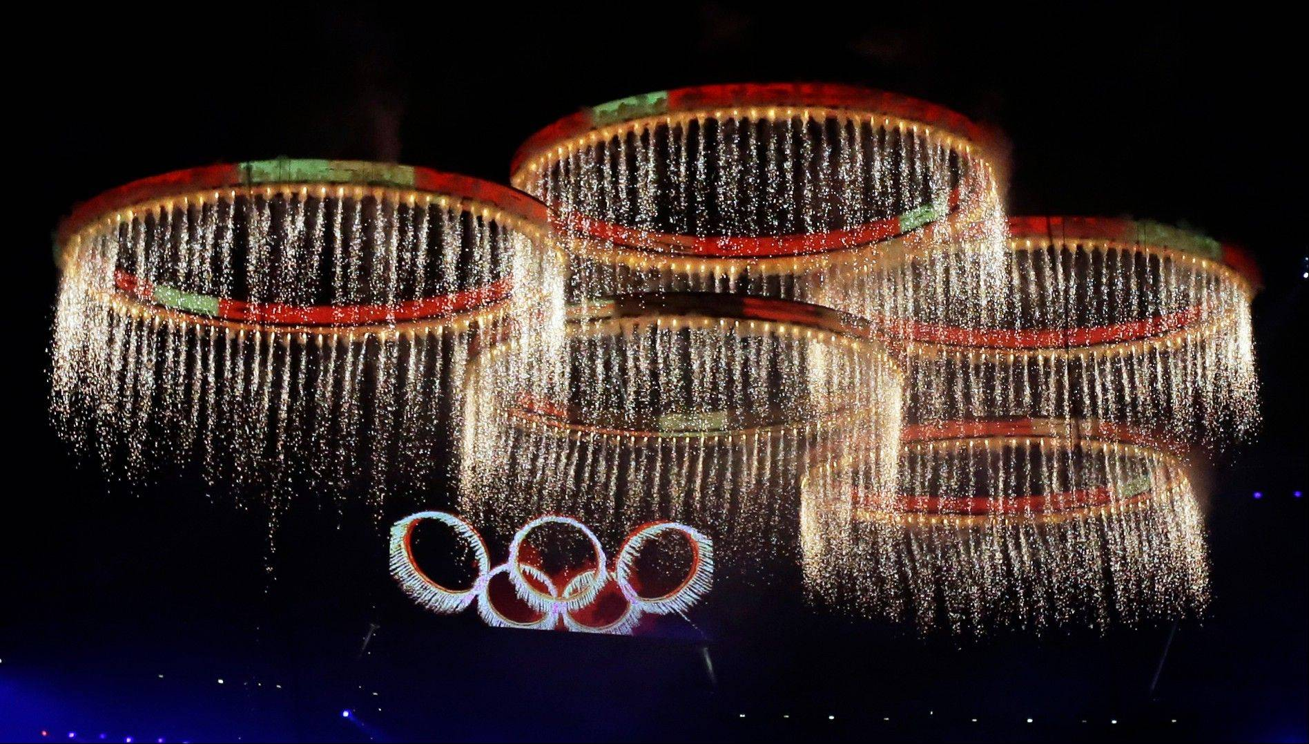 The Olympic rings are illuminated during the Opening Ceremony at the 2012 Summer Olympics, Friday, July 27, 2012, in London.