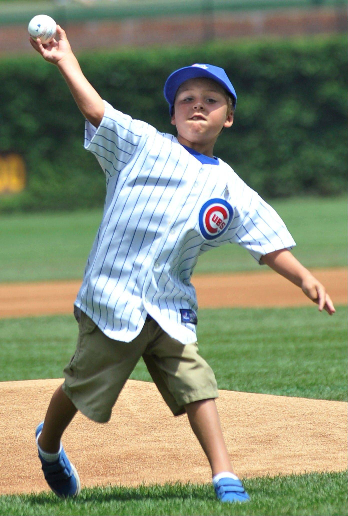 Seven-year-old Spencer Brown, grandson of Hall of Famer Ron Santo, throws out the ceremonial first pitch during Ron Santo Day on Friday at Wrigley Field.