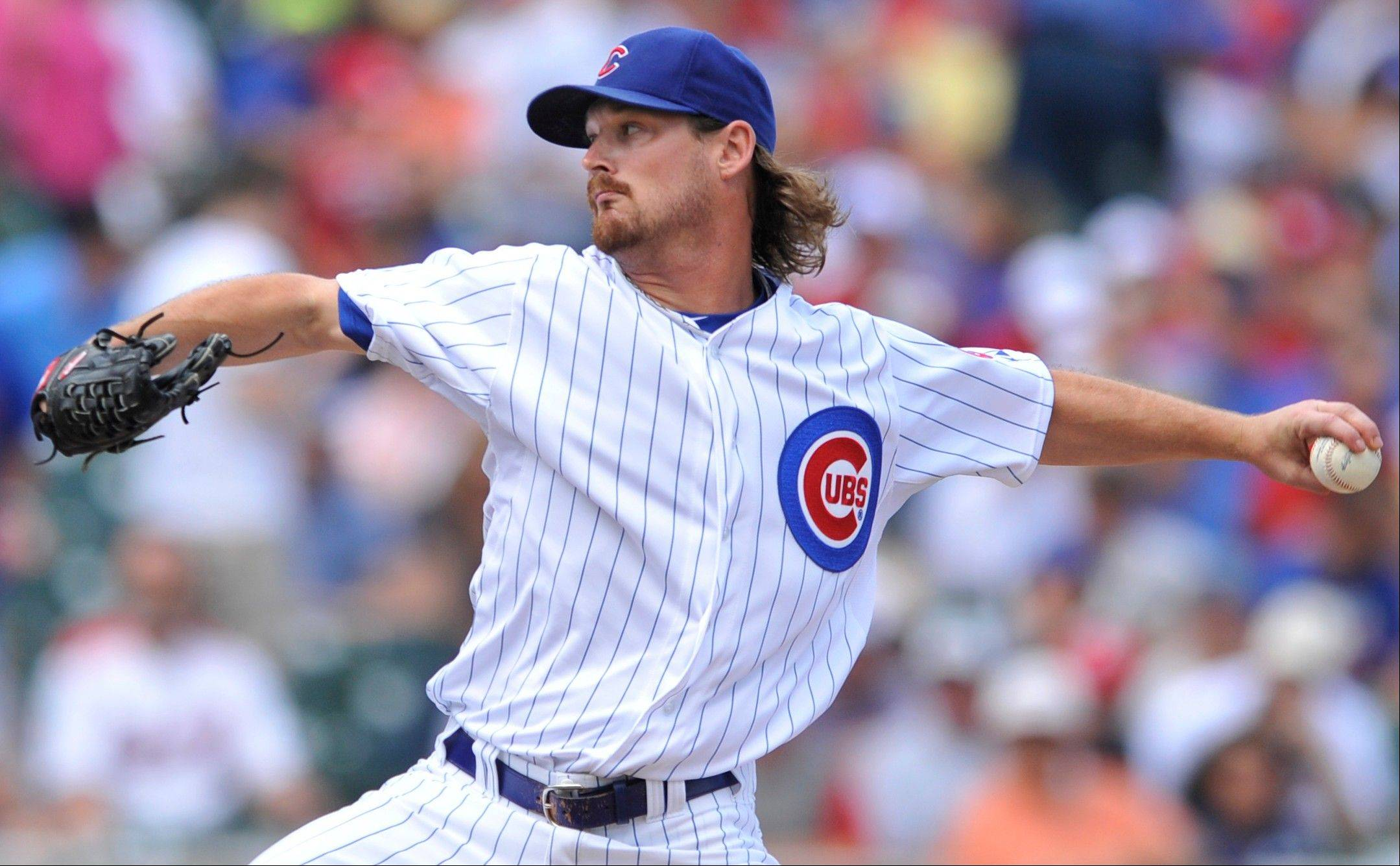 The Cubs' Travis Wood served up a home run in each of the first five innings Friday, becoming the first starting pitcher in major-league history to accomplish the dubious feat.