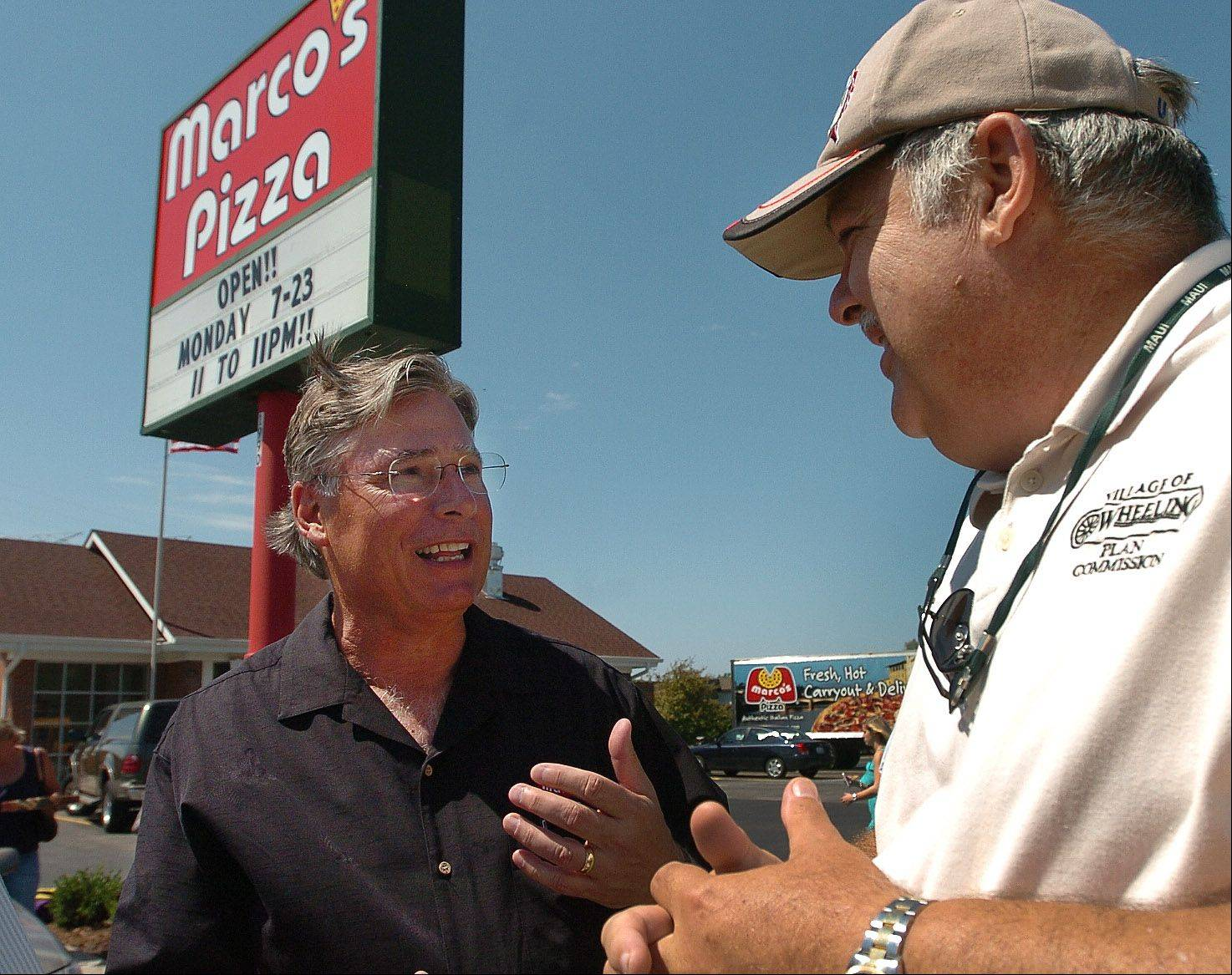 Marco's Pizza CEO Mack Butorac, left, chats with Wheeling Planning Commissioner Terry Steilen in front of the new Marco's Pizza in Wheeling.