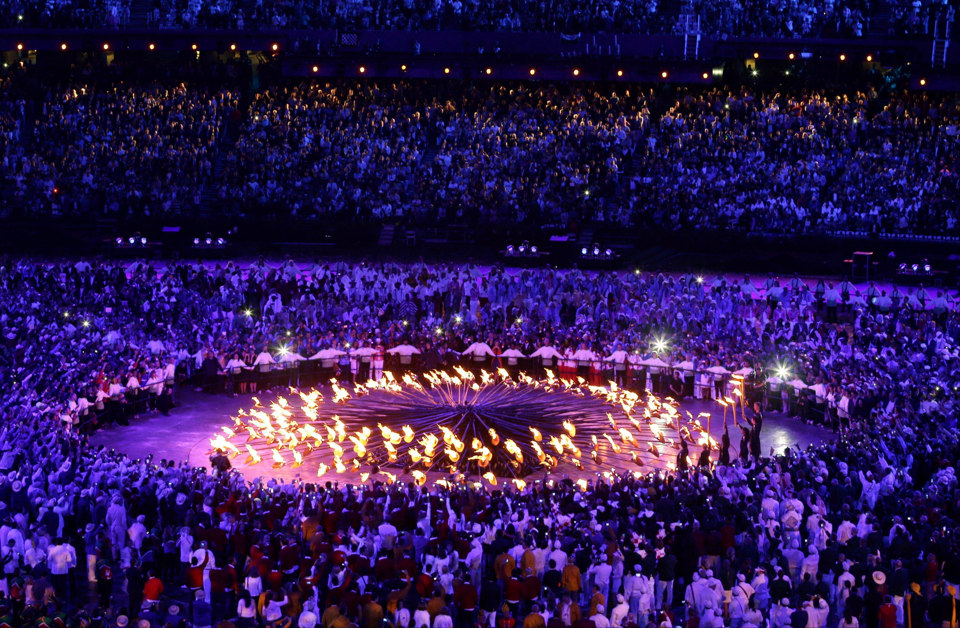 The Olympic caldron is lit during Friday's Opening Ceremony in London. NBC showed the ceremony on tape delay in the United States.