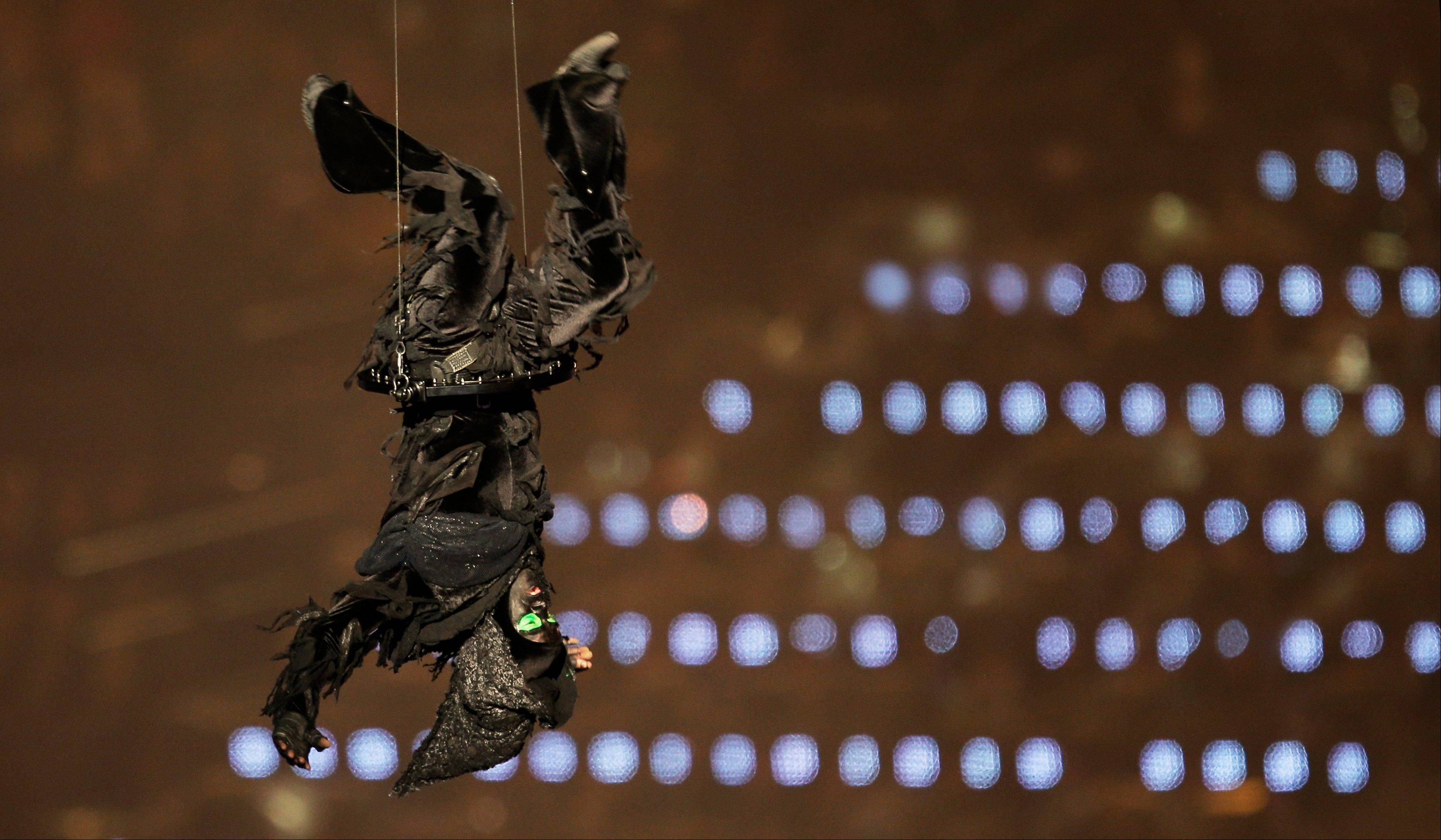 An actor takes flight during a performance at the Opening Ceremony at the 2012 Summer Olympics, Friday, July 27, 2012, in London.