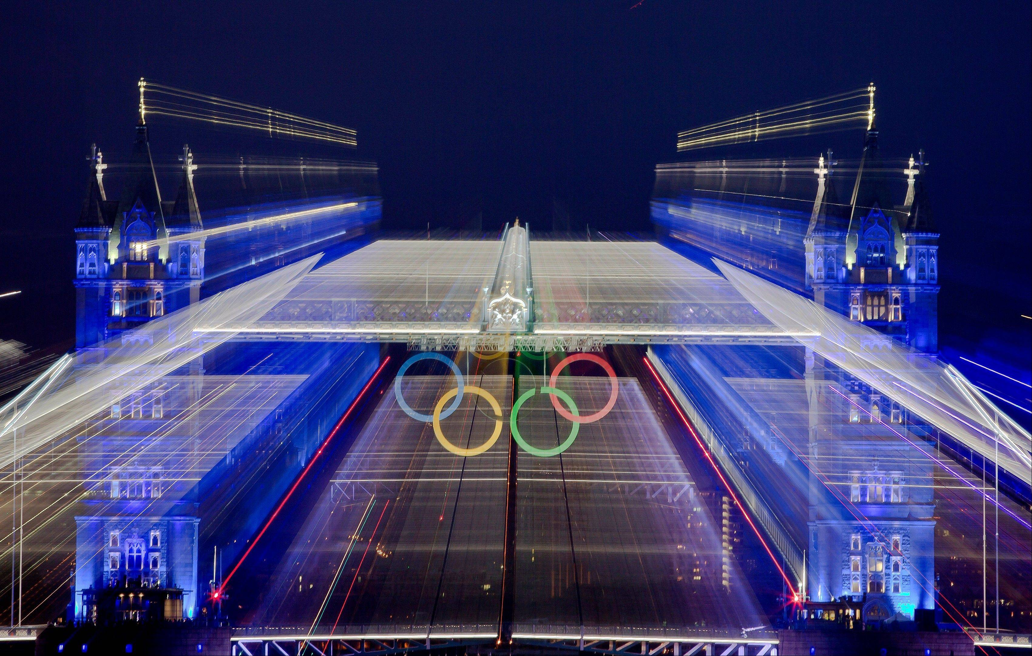The iconic Tower Bridge over the River Thames in central London, decorated with Olympic rings, is seen in this zoom exposure, during the Opening Ceremony at the 2012 Summer Olympics, Friday, July 27, 2012, in London.