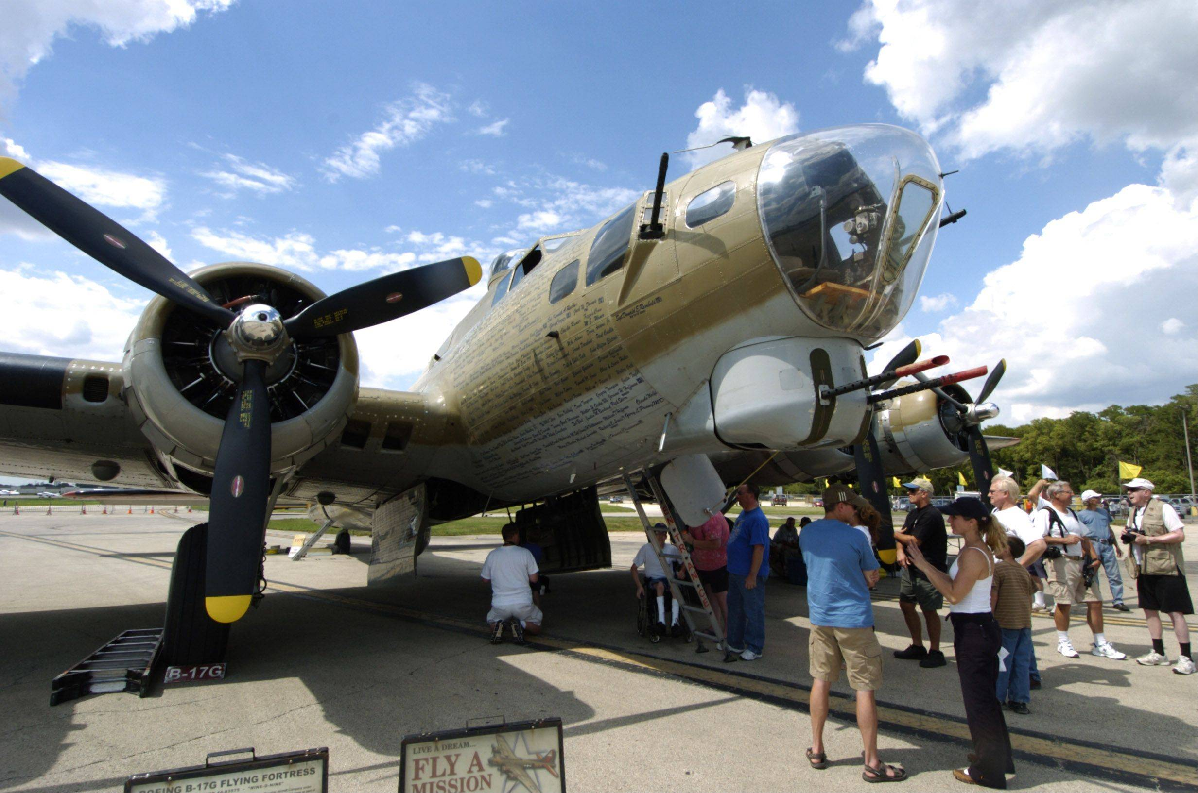 A B-17 is among the World War II planes on display during a Wings of Freedom stop at Chicago Executive Airport Friday.