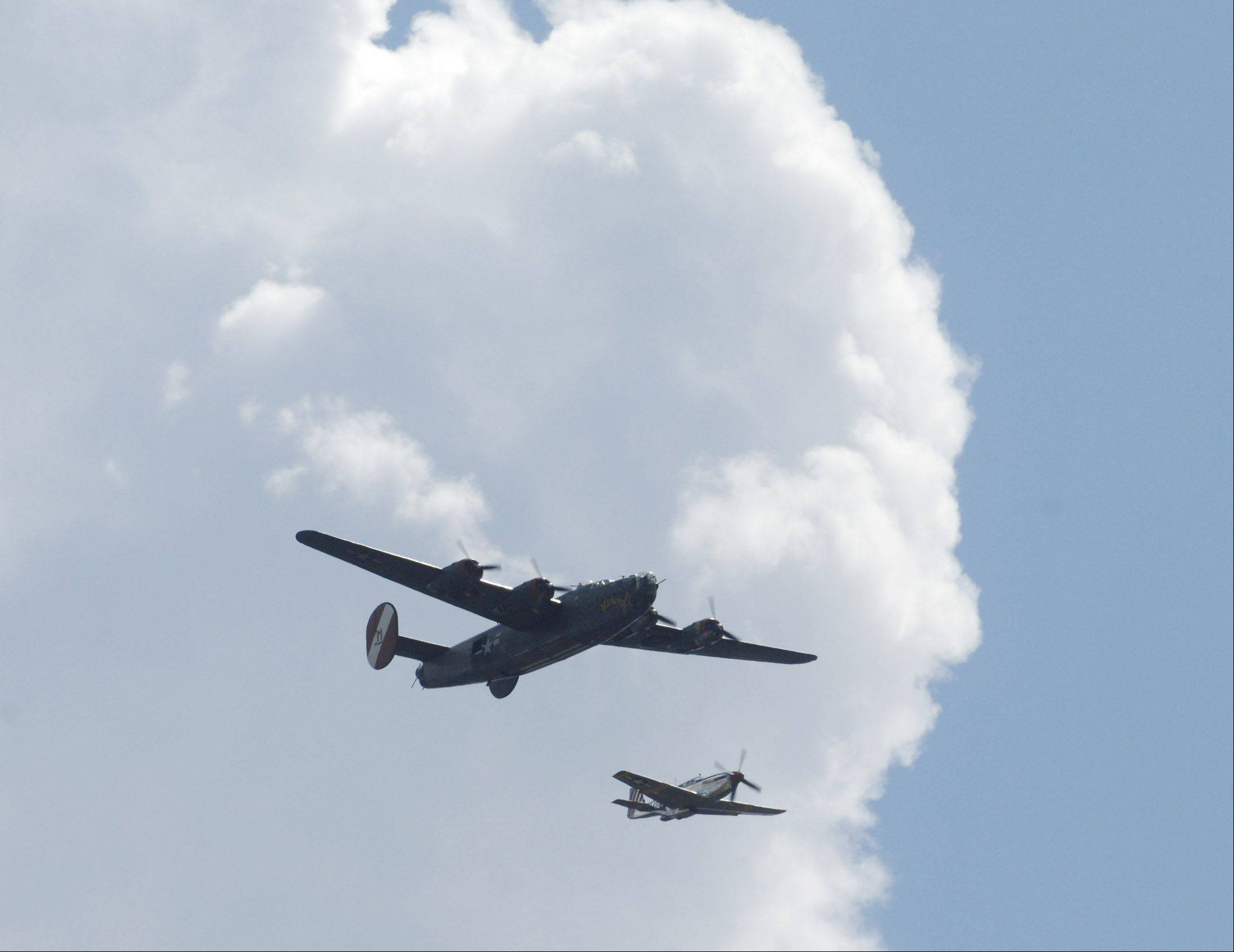 A B-24 and a P-51 Mustang arrive at Chicago Executive Airport Friday to be put on display.