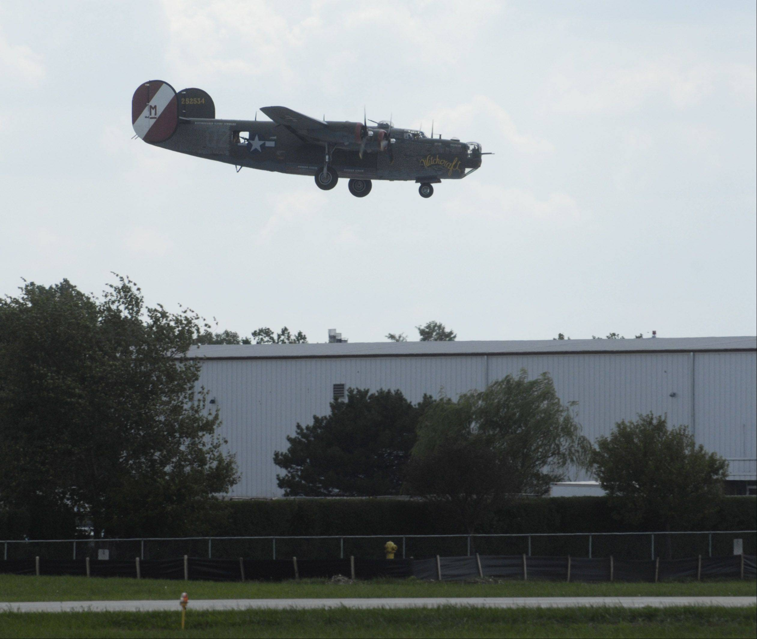 A B-24 lands prior to its display for the Wings of Freedom stop at Chicago Executive Airport Friday.