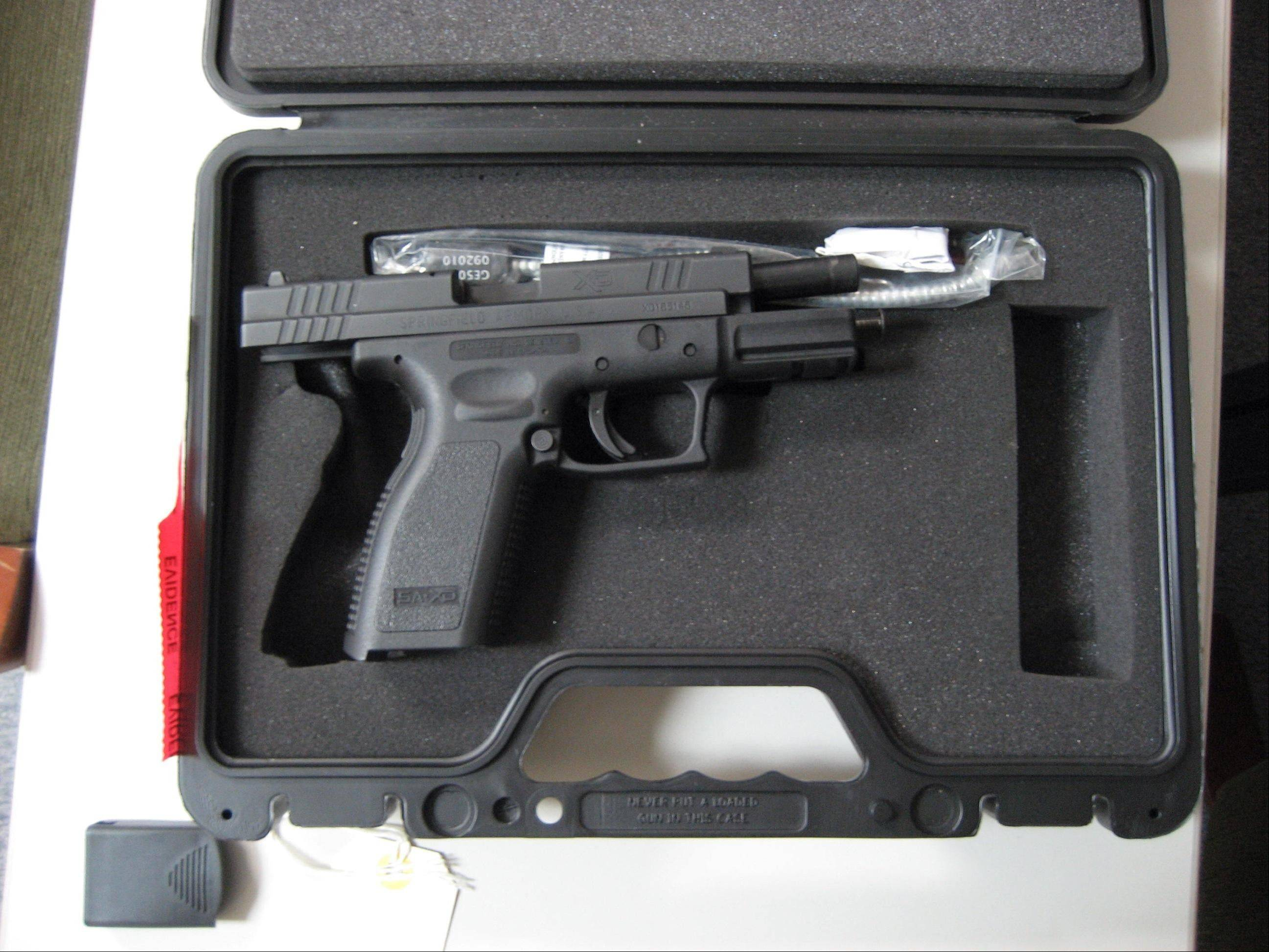 Round Lake Park police say Glenford O. Coombs of Volo used this loaded 9 mm semiautomatic pistol to threaten a man and his 11-year-old daughter Tuesday. Police said they also recovered roughly 100 rounds of 9 mm ammunition from Coombs' Mercedes-Benz.
