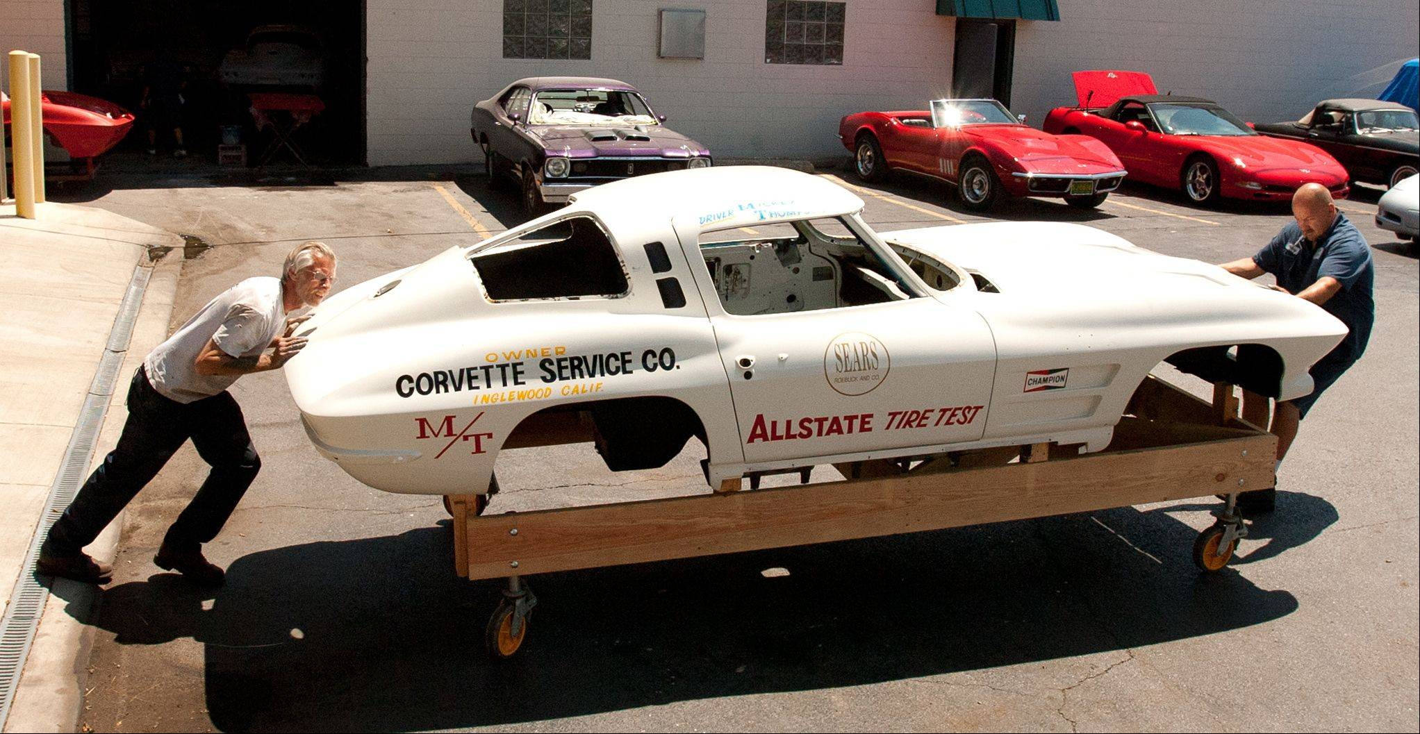 Kuczkowski pushes Mickey Thompson's 1963 split window Corvette Coupe to begin its body restoration.