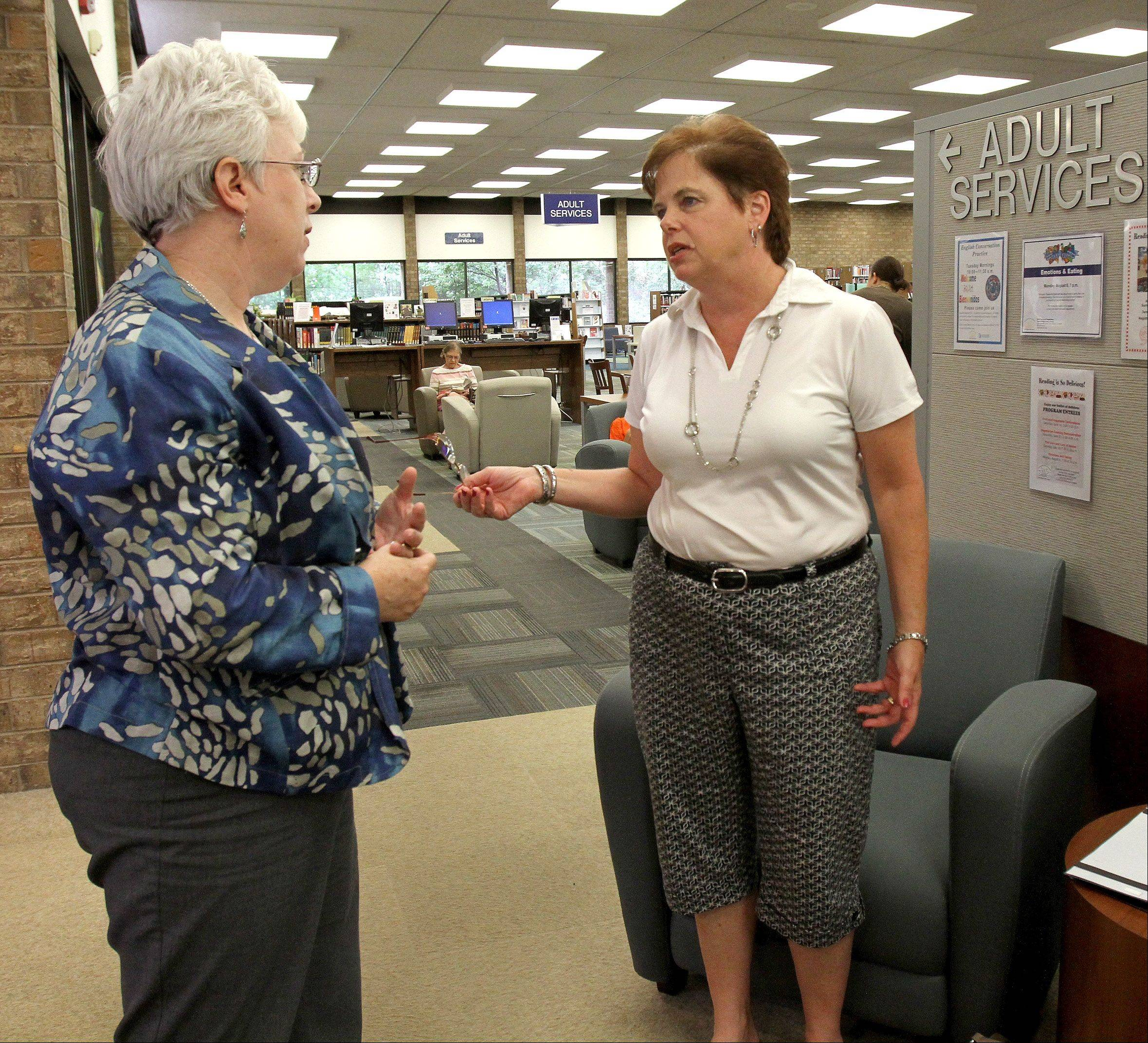 Former Carol Stream Library Director Ann Kennedy, right, talks with Interim Library Director Mary Clemens on Thursday, a day after the library board voted to fire Kennedy.