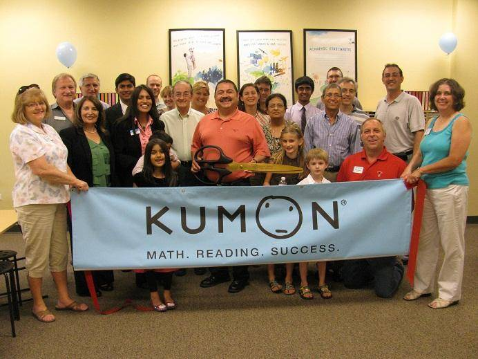 Acting Mayor Ruben Pineda (center holding scissors), joined by well-wishers and members of the Western DuPage Chamber of Commerce, assists business owner Yasmeen Syed with cutting the ribbon for her new business, Kumon of West Chicago, located at 946 N. Neltnor Blvd. in West Chicago.