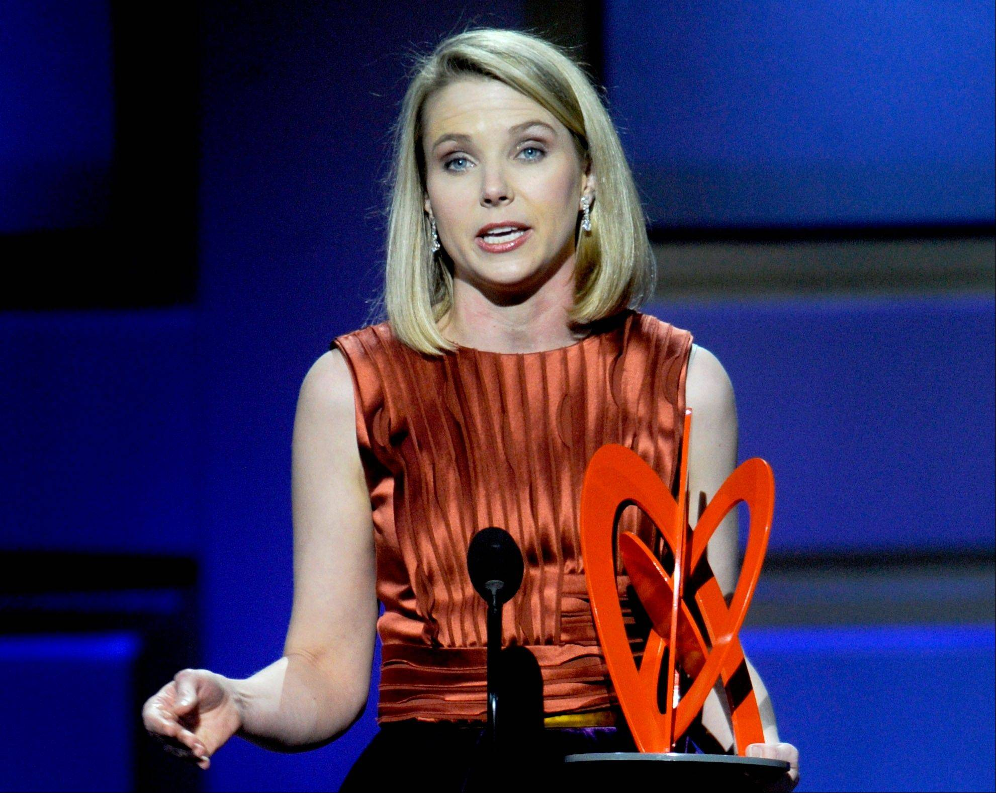 Marissa Mayer, who was named Yahoo Inc.�s CEO on July 16, accepts her award at Glamour magazine�s 2009 Women of the Year awards at Carnegie Hall in New York. Yahoo is giving Mayer a compensation package worth more than $59 million over the next several years.