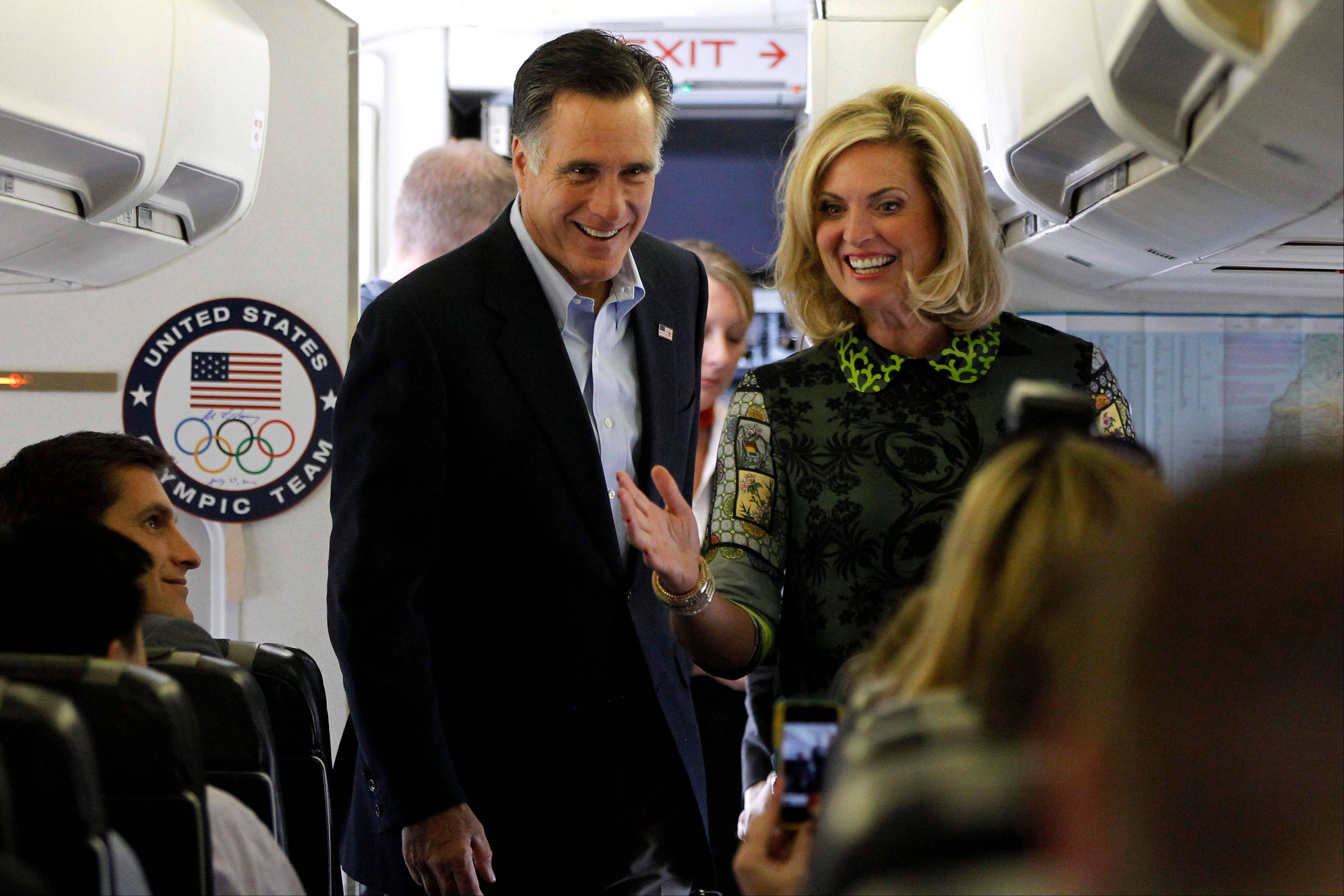 Republican presidential candidate and former Massachusetts Gov. Mitt Romney and his wife Ann board his charter plane Saturday at London Stansted Airport as he travels to Israel.