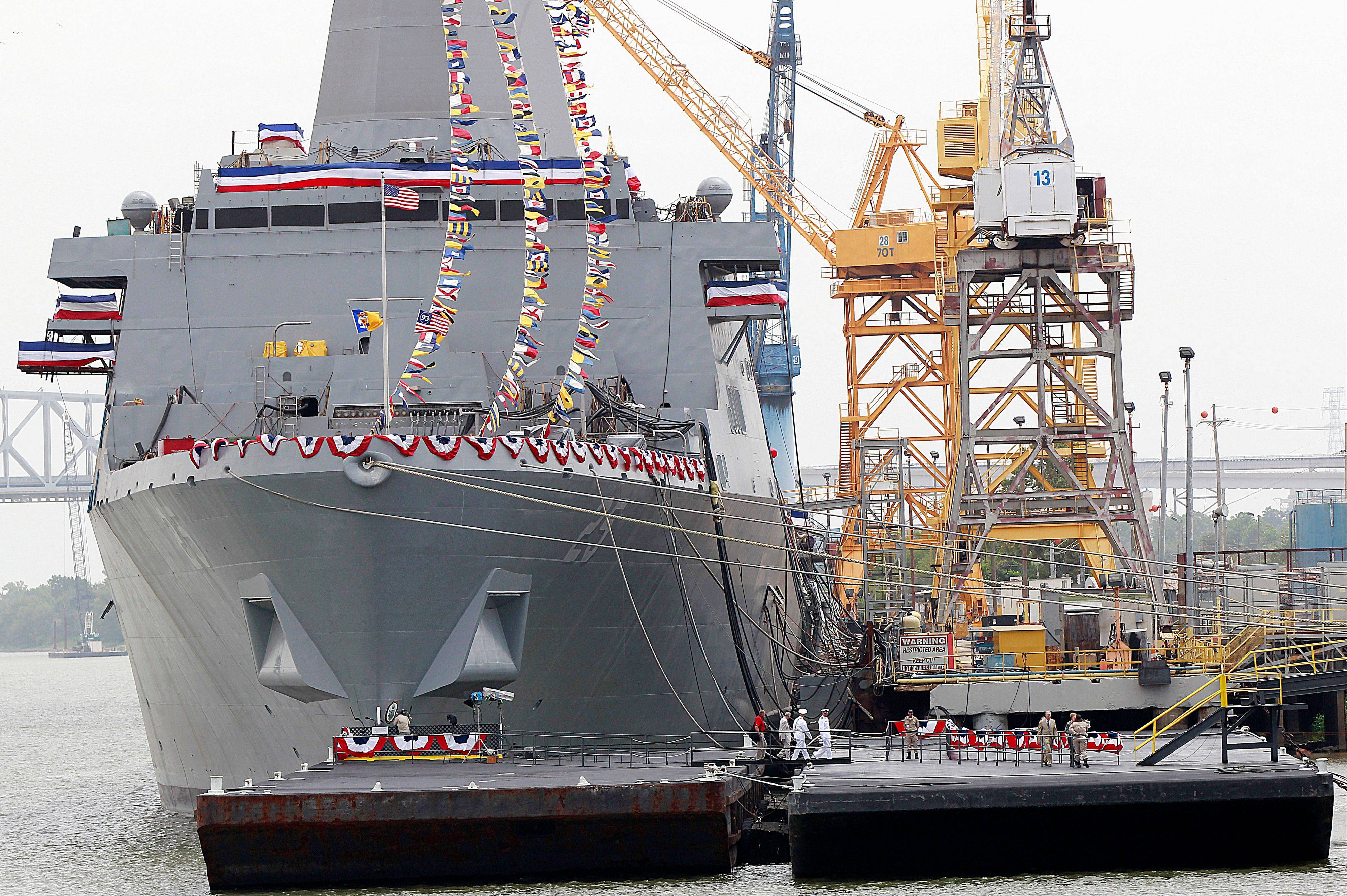Dignitaries walk back to the dock Saturday after christening the USS Somerset at the Huntington Ingalls Industries Shipyard in Avondale, La.