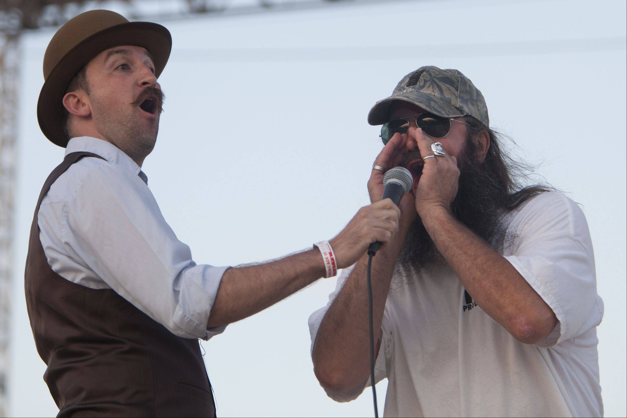 Tom Bernard of Mundelein attempts to call Sasquatch on Friday night as emcee Matt Campbell opens his mouth in amazement at the Lake County Fair in Grayslake.