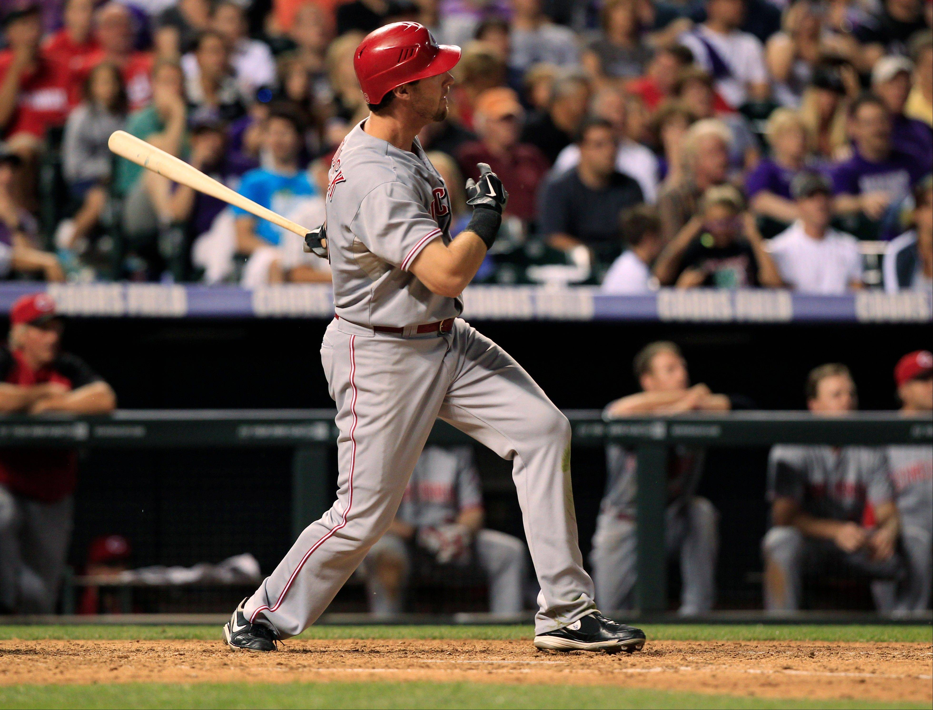 The Reds� Ryan Ludwick follows the flight of his home run against the Colorado Rockies in the eighth inning Saturday in Denver.