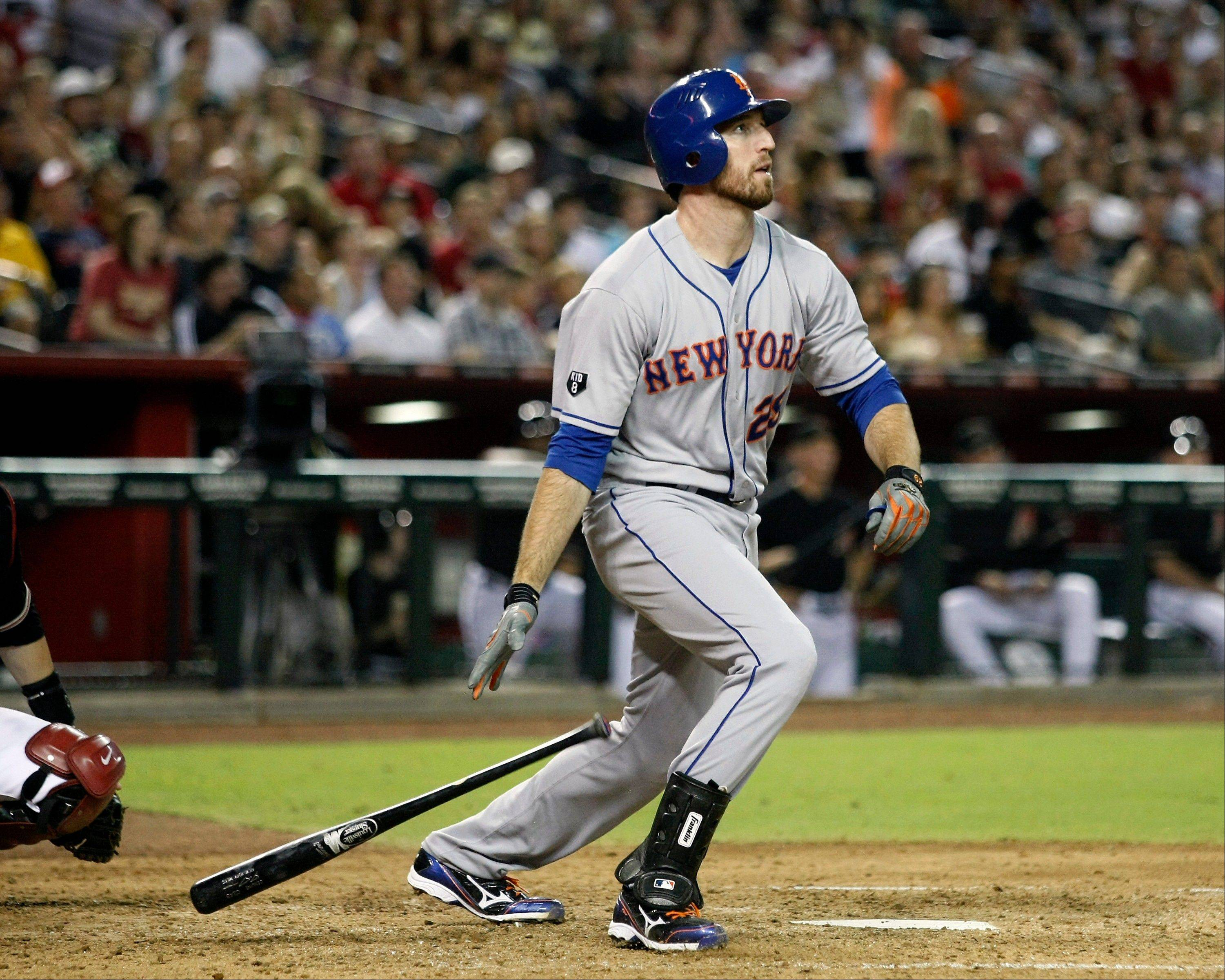 The Mets� Ike Davis hits his third home run of the game Saturday against the Diamondbacks in Phoenix.