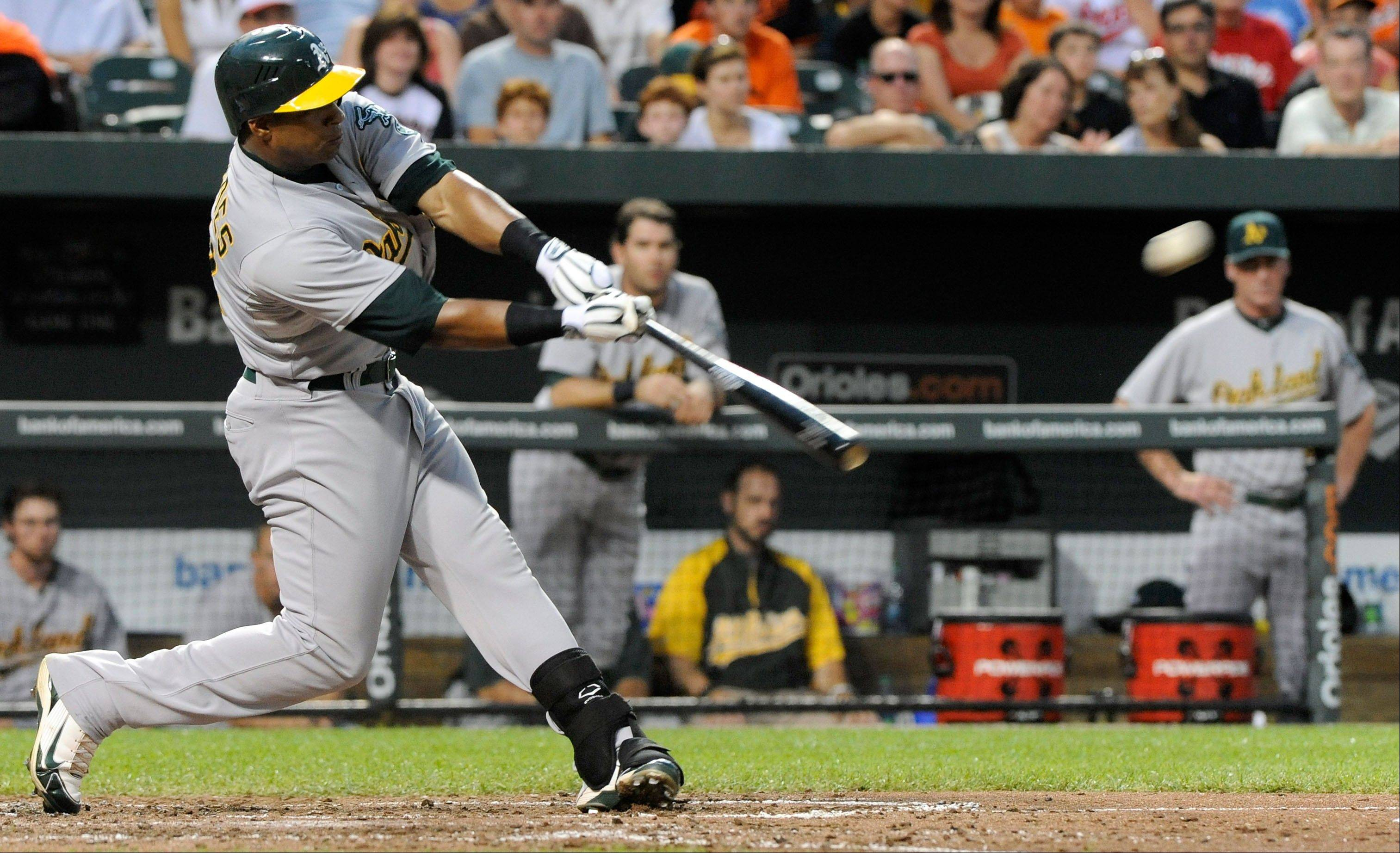 Oakland�s Yoenis Cespedes hits a two-run home run in the fourth inning Saturday in Baltimore.