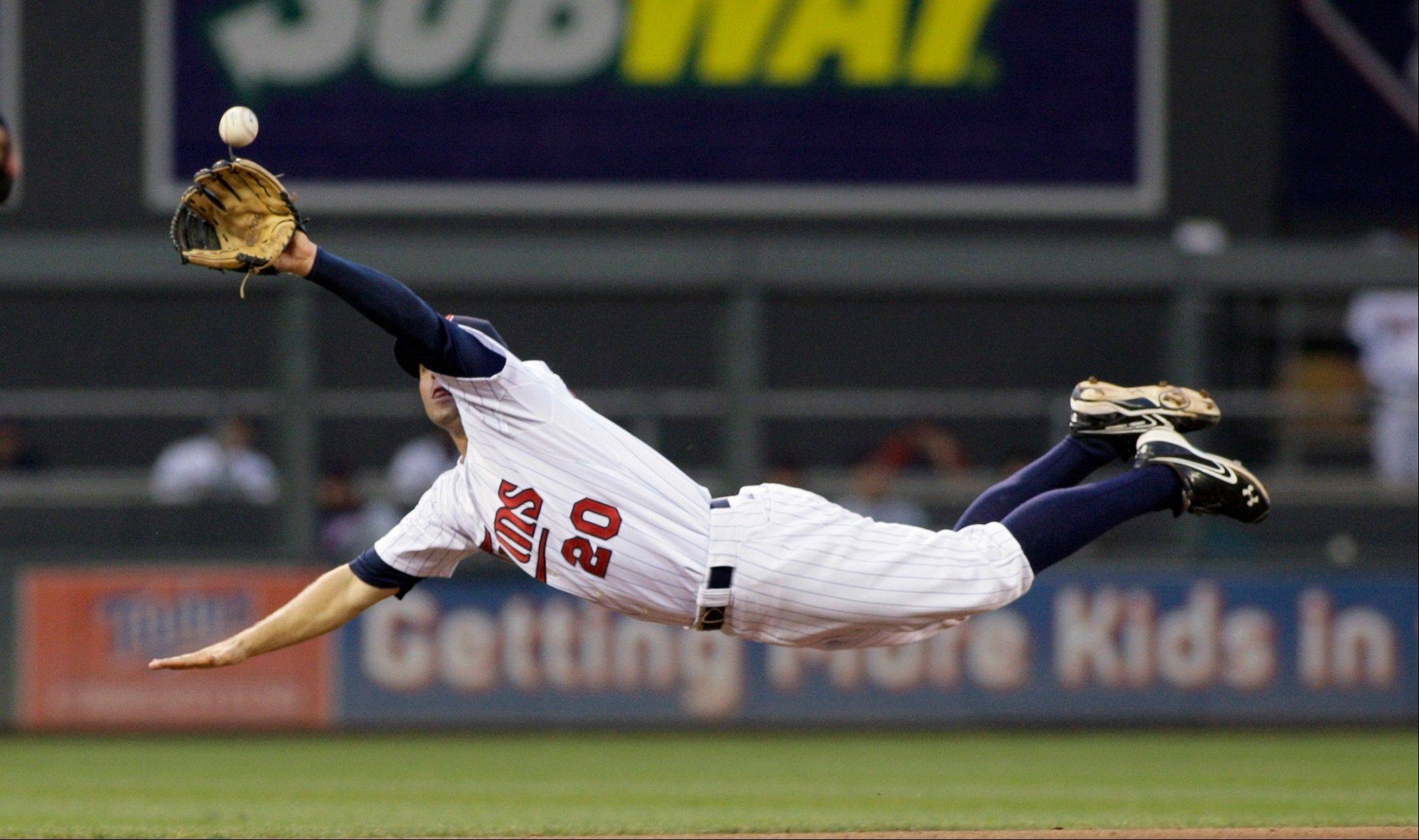 Twins shortstop Brian Dozier makes a diving catch on a line drive by Cleveland�s Brent Lillibridge during the seventh inning Saturday in Minneapolis.