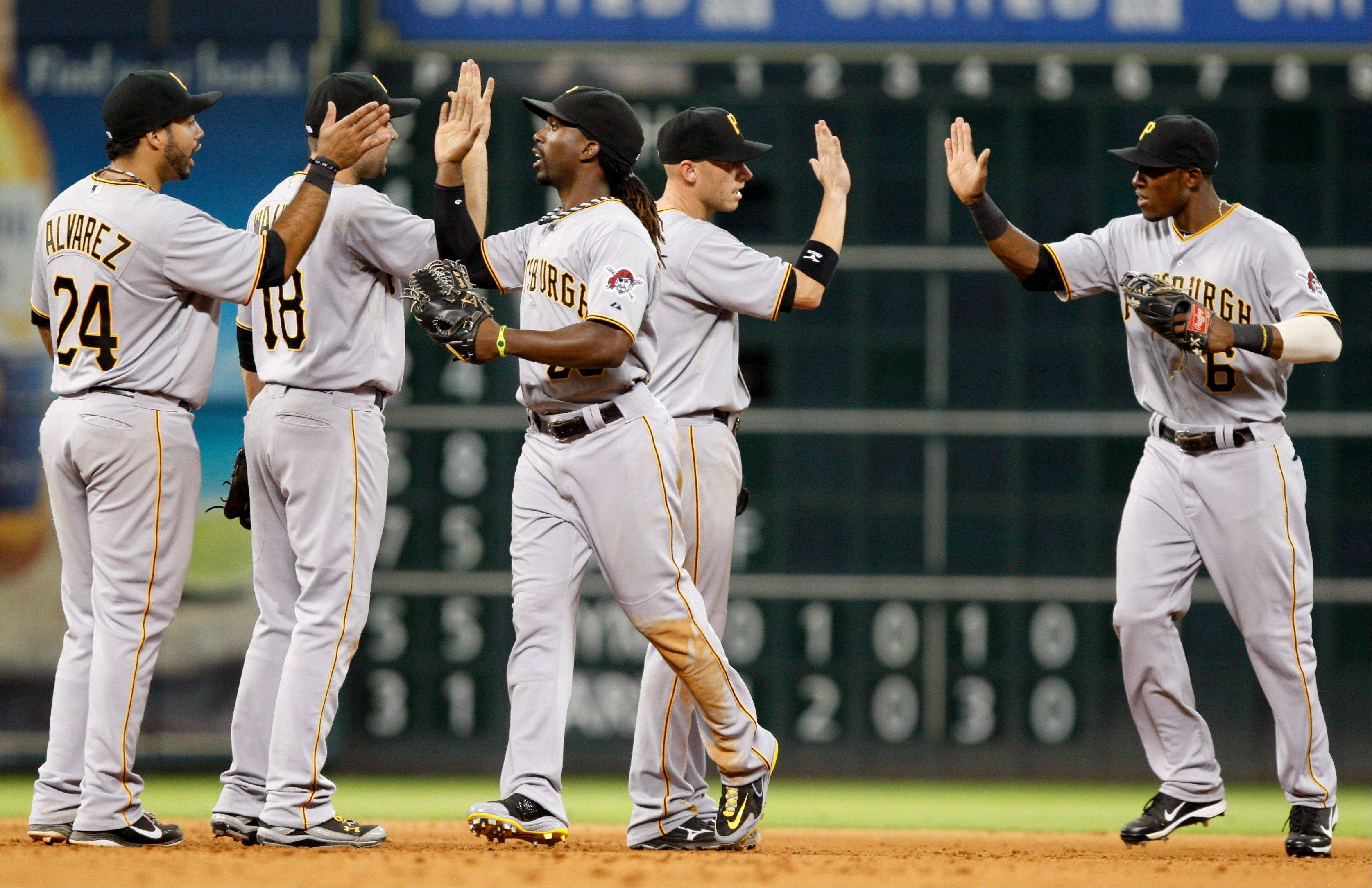 The Pittsburgh Pirates celebrate their win over the Astros Saturday in Houston.