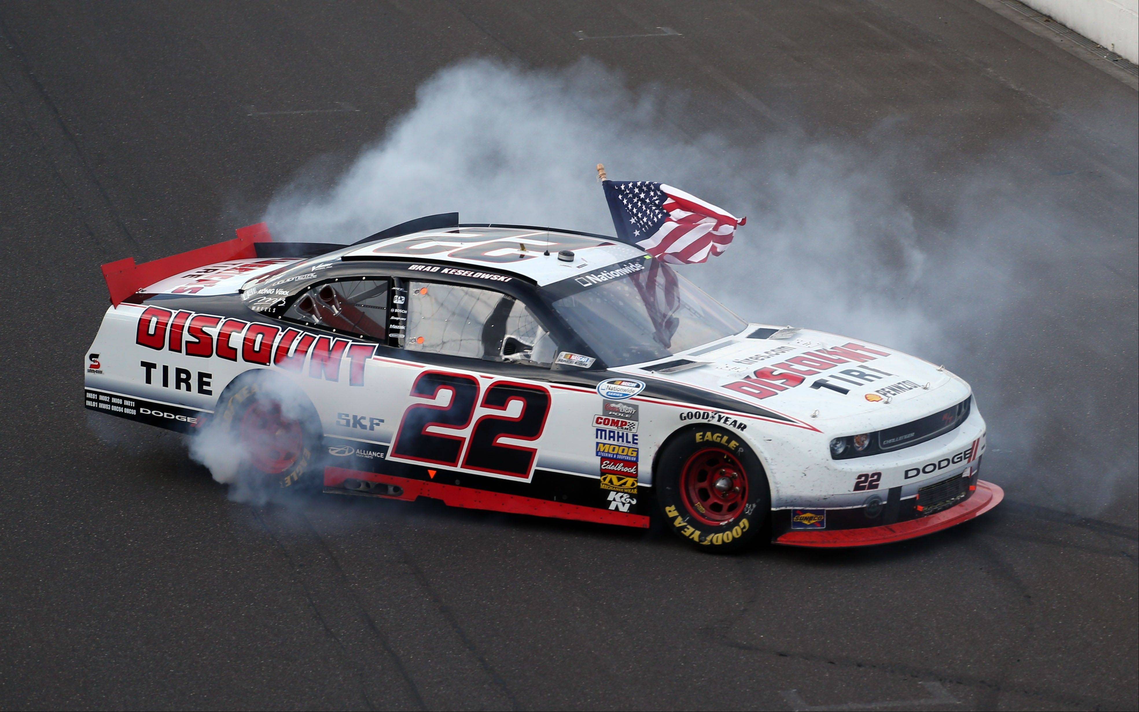 Brad Keselowski celebrates his win Saturday in the NASCAR Nationwide Series auto race at Indianapolis Motor Speedway in Indianapolis.