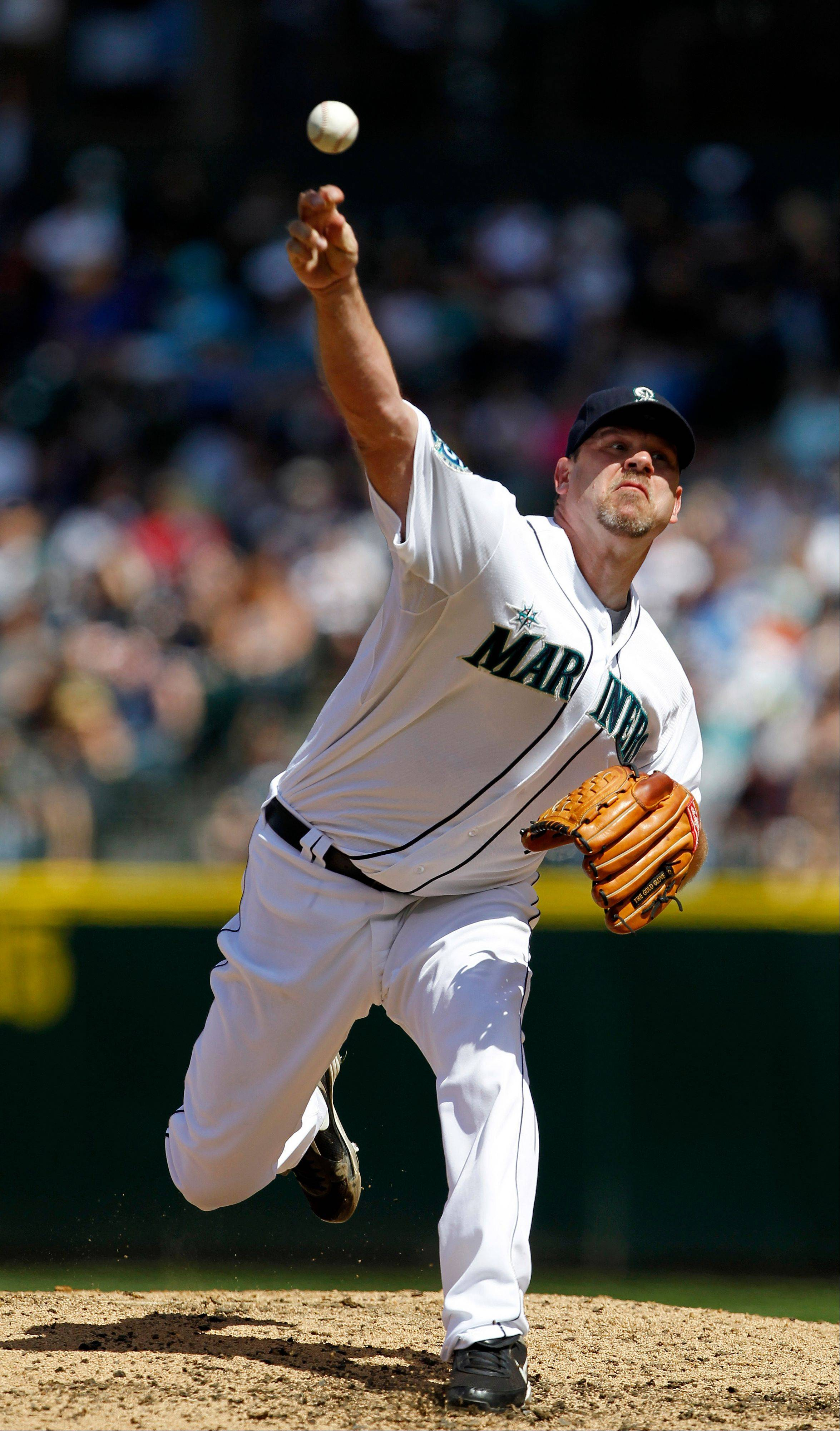 Mariners starting pitcher Kevin Millwood throws against the Kansas City Royals on Saturday in Seattle.