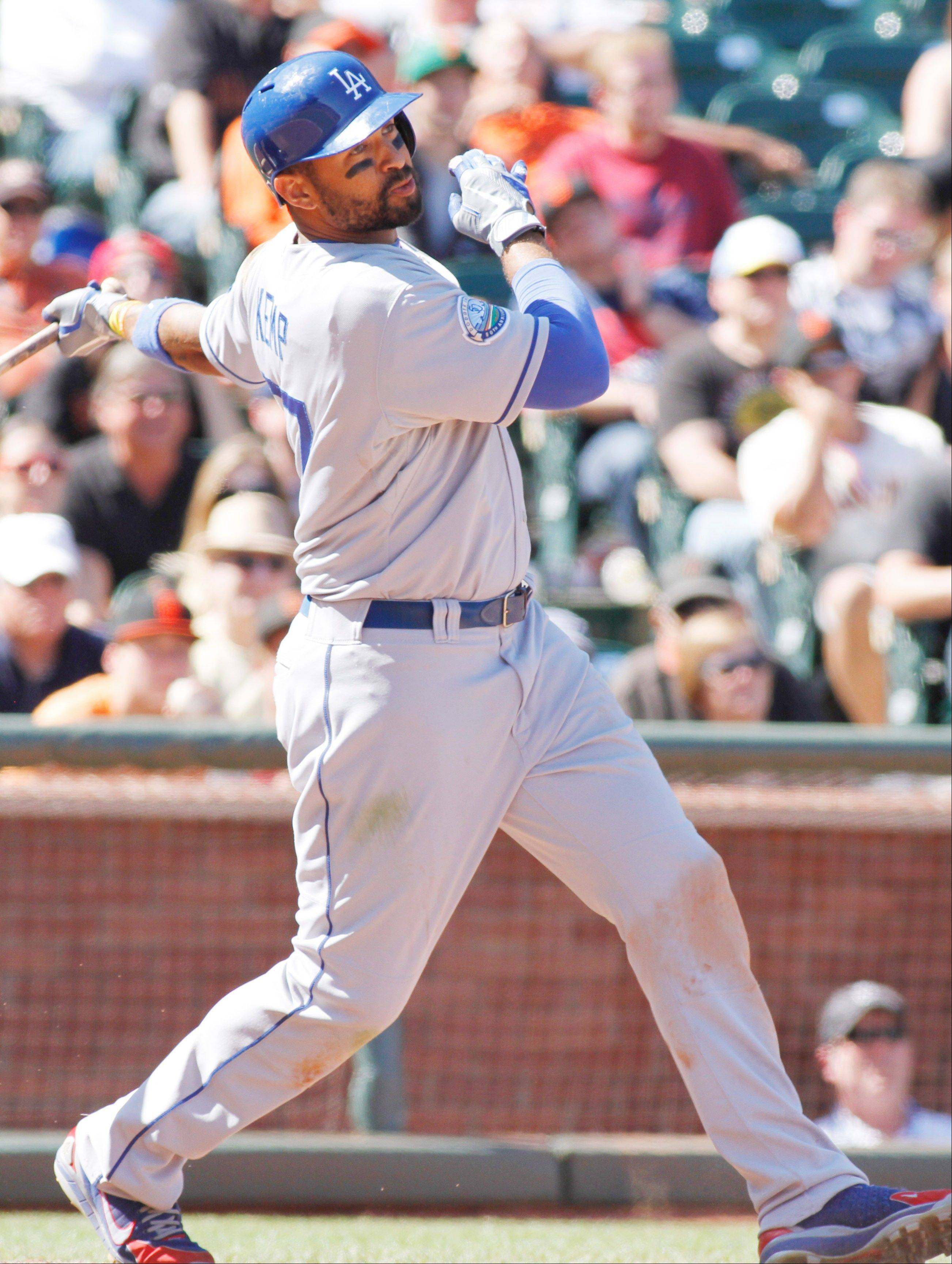 The Dodgers� Matt Kemp hits an RBI double in the ninth inning Saturday against the Giants in San Francisco.