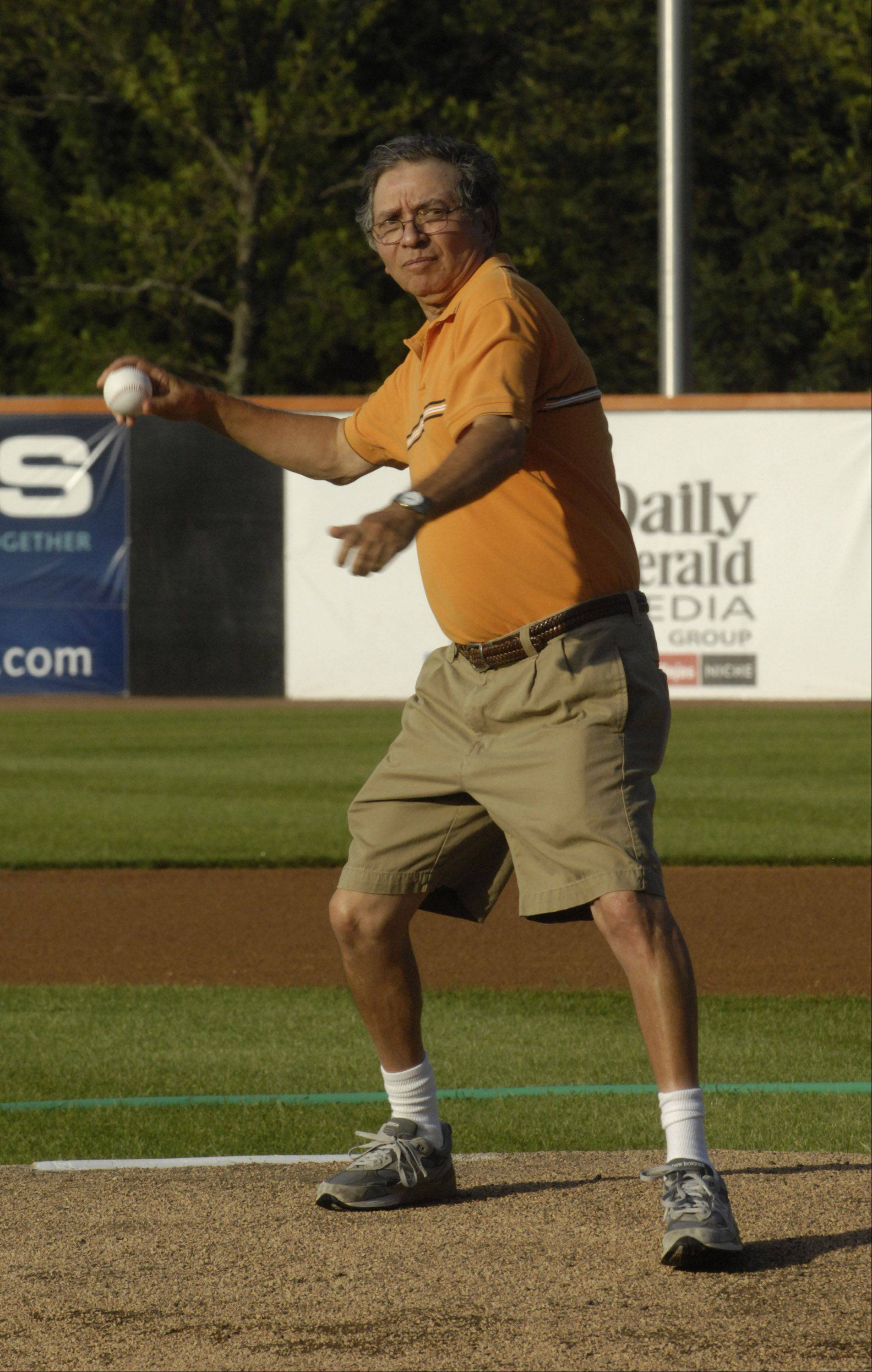 JOE LEWNARD/jlewnard@dailyherald.com Daily Herald Sports Columnist Mike Imrem throws out the first pitch before Wednesday's Schaumburg Boomers game.