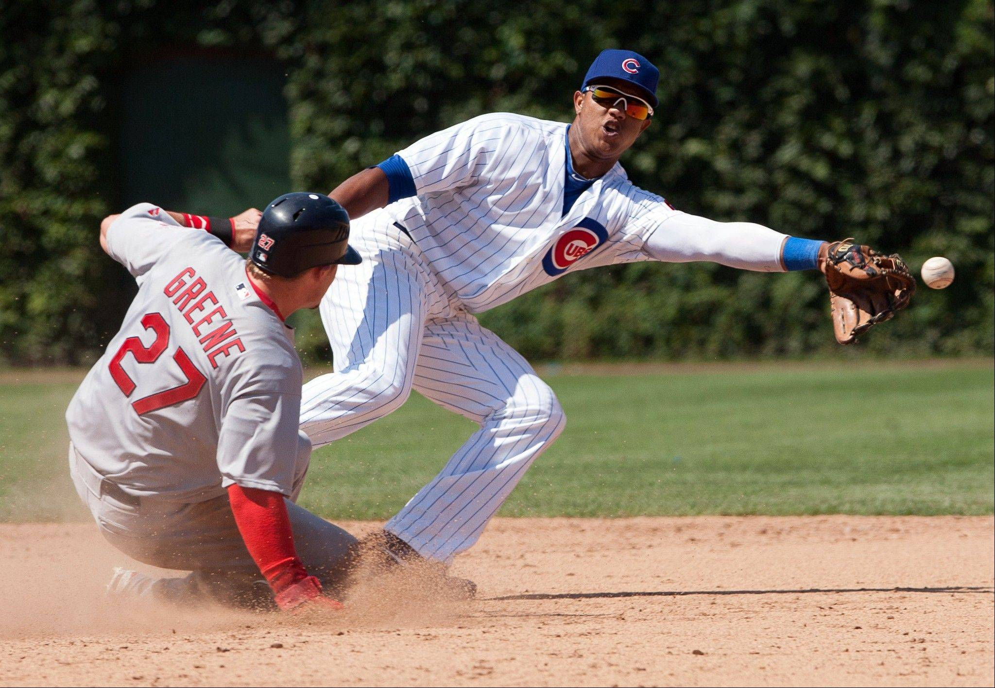 Tyler Greene steals second base in the ninth inning as Starlin Castro fails to handle the throw Saturday at Wrigley Field.