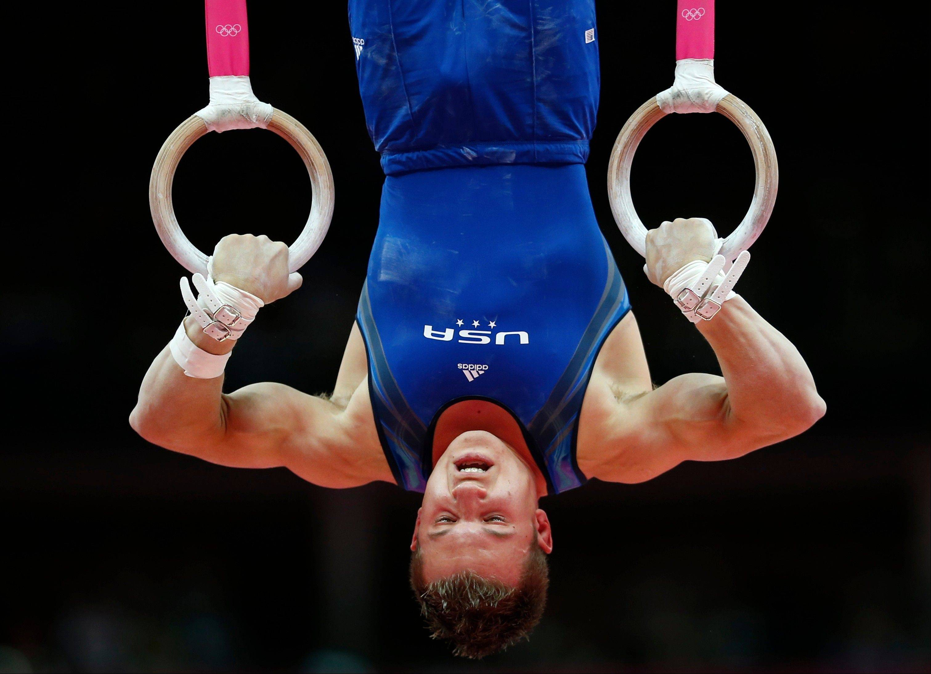 U.S. gymnast Jonathan Horton performs on the rings during men�s team preliminary round on Saturday in London.