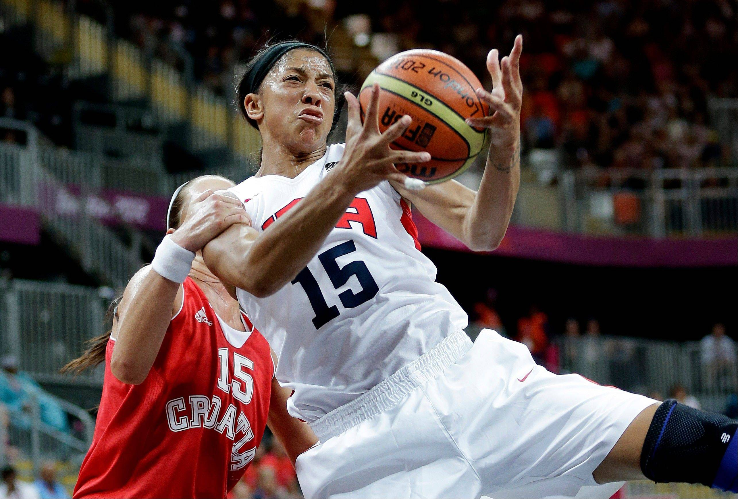 USA�s Candace Parker, right, is grabbed from behind by Croatia�s Jelena Ivezic during the second half of a preliminary women�s basketball game Saturday at the London Olympics.