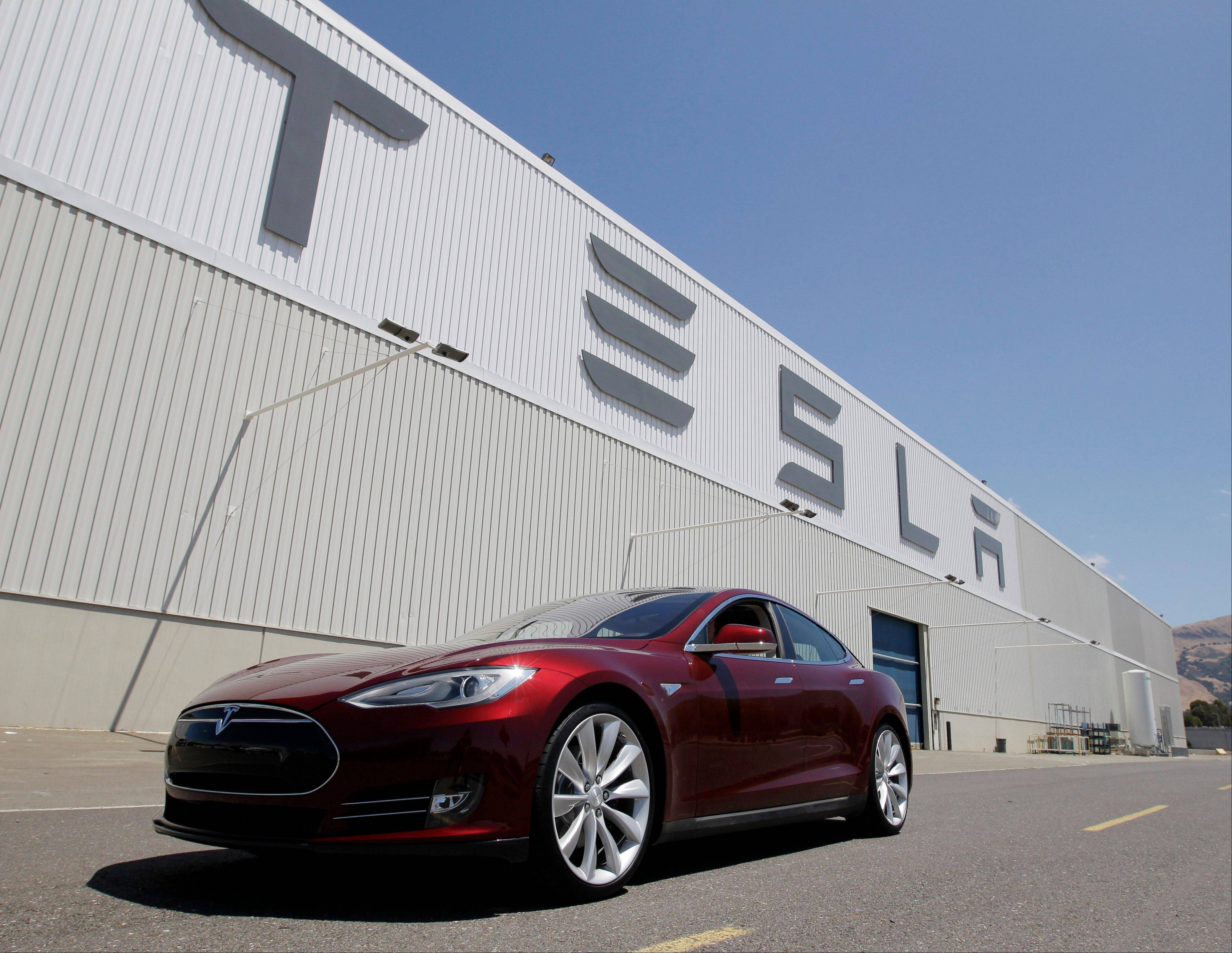 A Tesla Model S outside the Tesla factory in Fremont, Calif. The Model S is an upscale electronic car that has features such as 17-inc Wi-Fi touch screen instead of a traditional display.