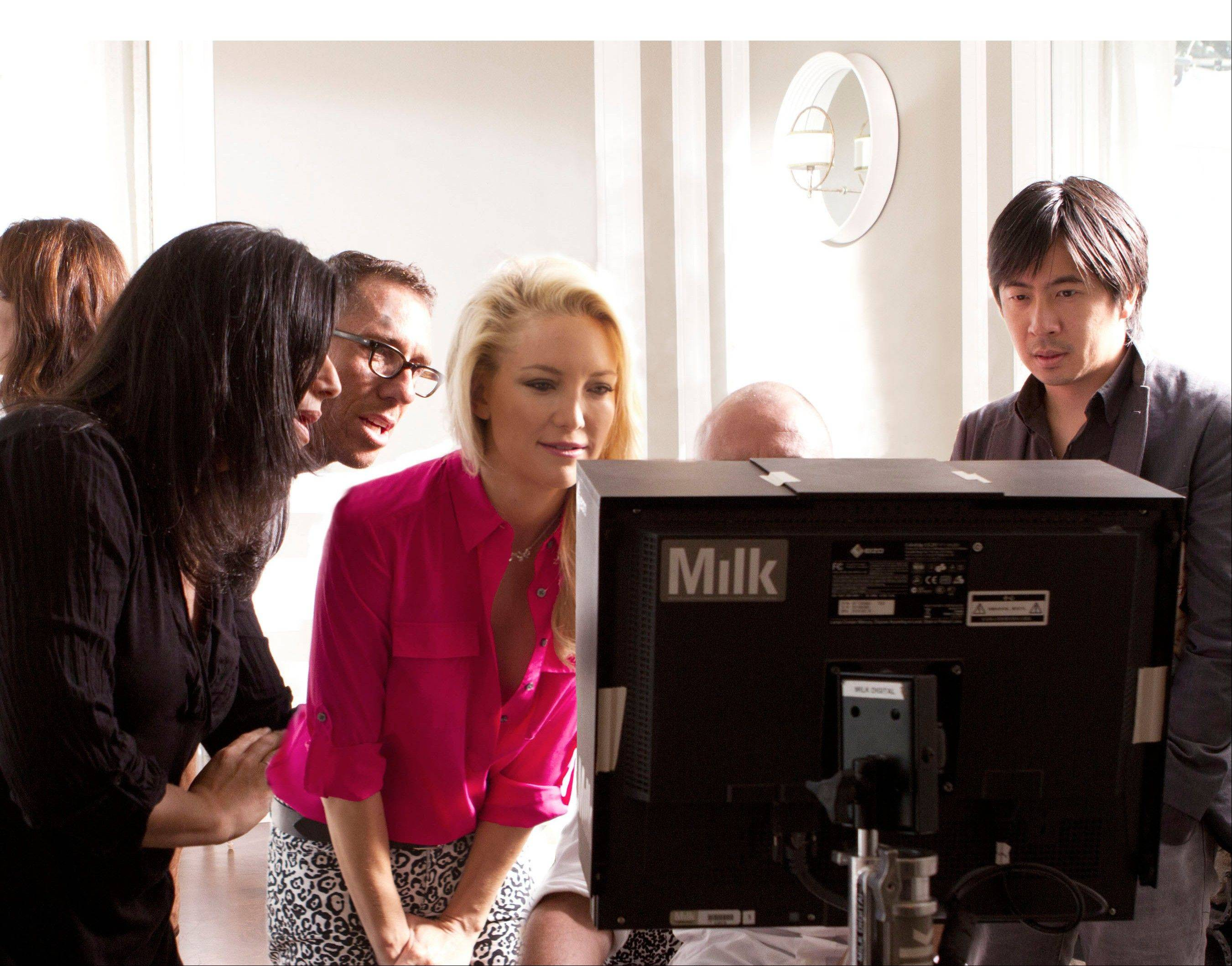 Kate Hudson works closely with Ann Taylor team on set while shooting Ann Taylor's Fall 2012 ad campaign in Pasadena, California.