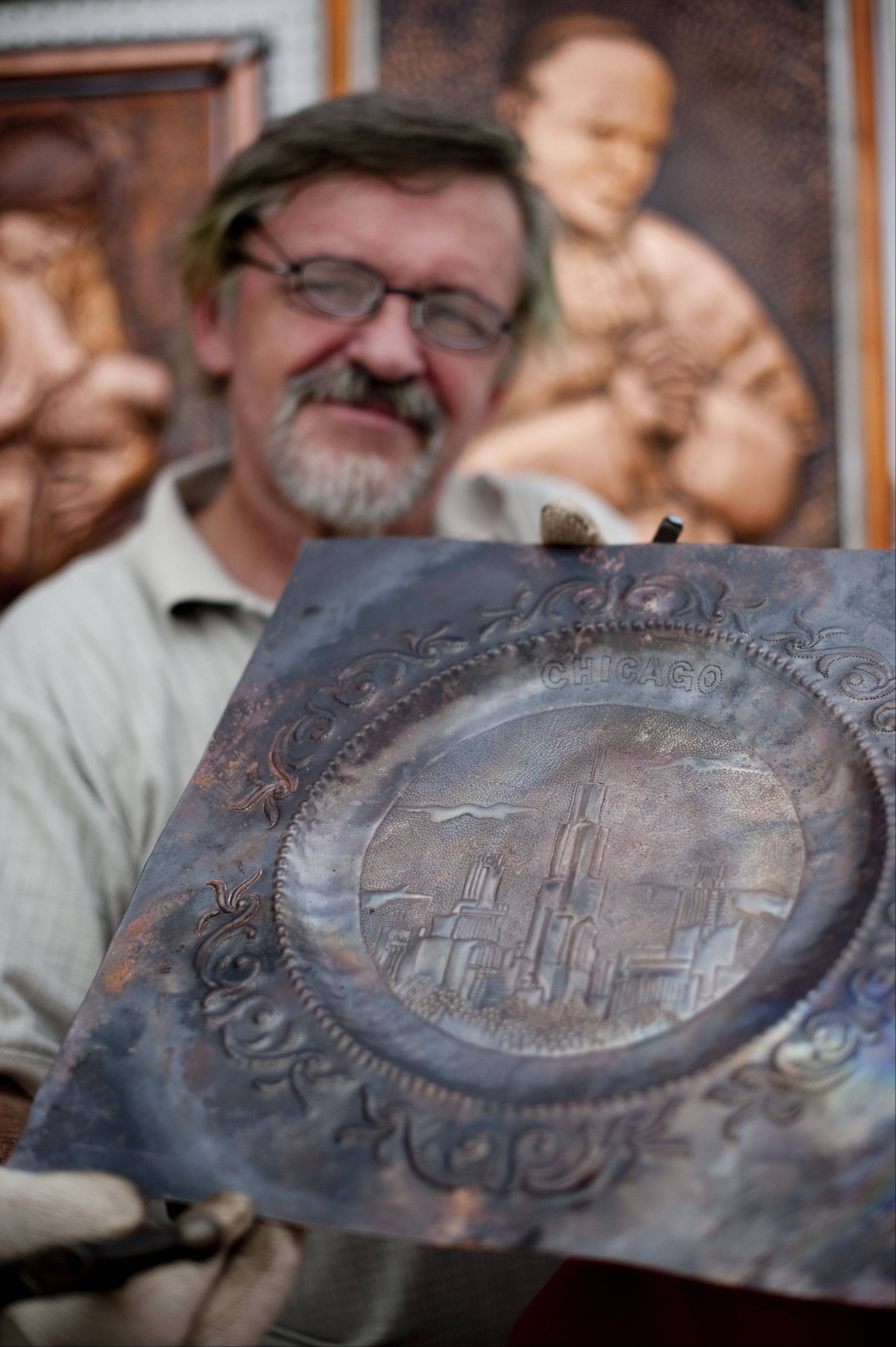 Jozef Andrzejczuk of Mount Prospect displays his copper work at Art & Soul on the Fox in downtown Elgin. The festival features artists working with a variety of mediums including ceramics, glass, metal, photography, watercolors, wood and more.