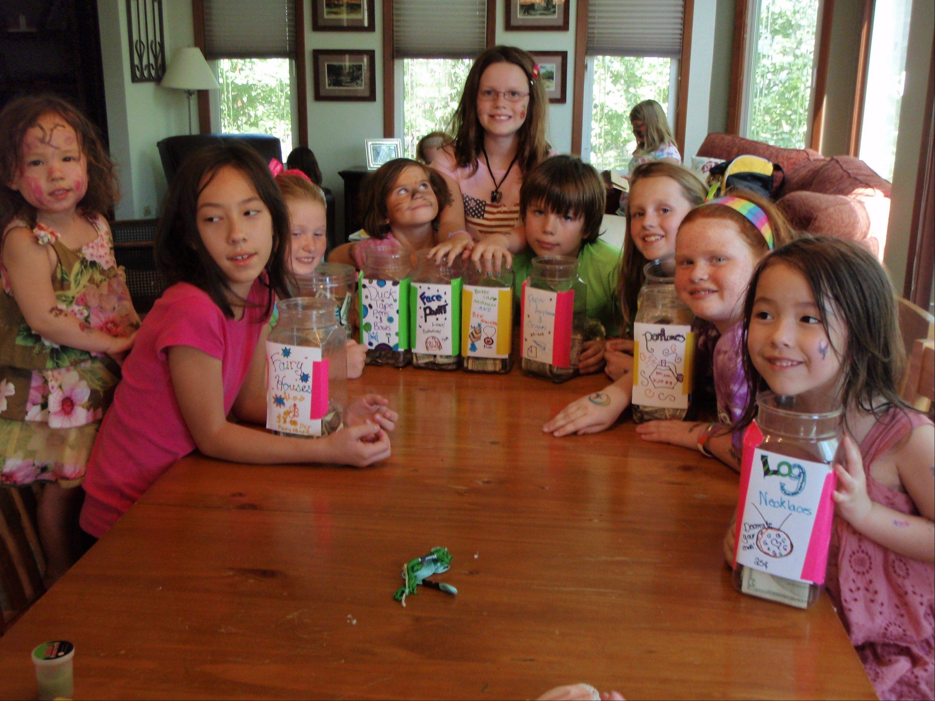 Ten-year-old Abby Glenzinski of Lombard, second from right, and several of her friends hosted a Fun Fair Wednesday and raised more than $700 for the family of 5-year-old heart transplant recipient Tim Grobart of Lombard. Shown here with the crafts they sold for donations are Niamh Lashmet, 2, of Lombard; Fiona Lashmet, 10, of Lombard; Grace Van Petten, 10, of Lombard; Cleo Glenzinski, 5, of Lombard; Nicole Farrow, 10, of Elmhurst; Thomas Glenzinski, 9, of Lombard; Shannon Farrow, 8, of Elmhurst; Abby; and Callie Lashmet, 5, of Lombard.