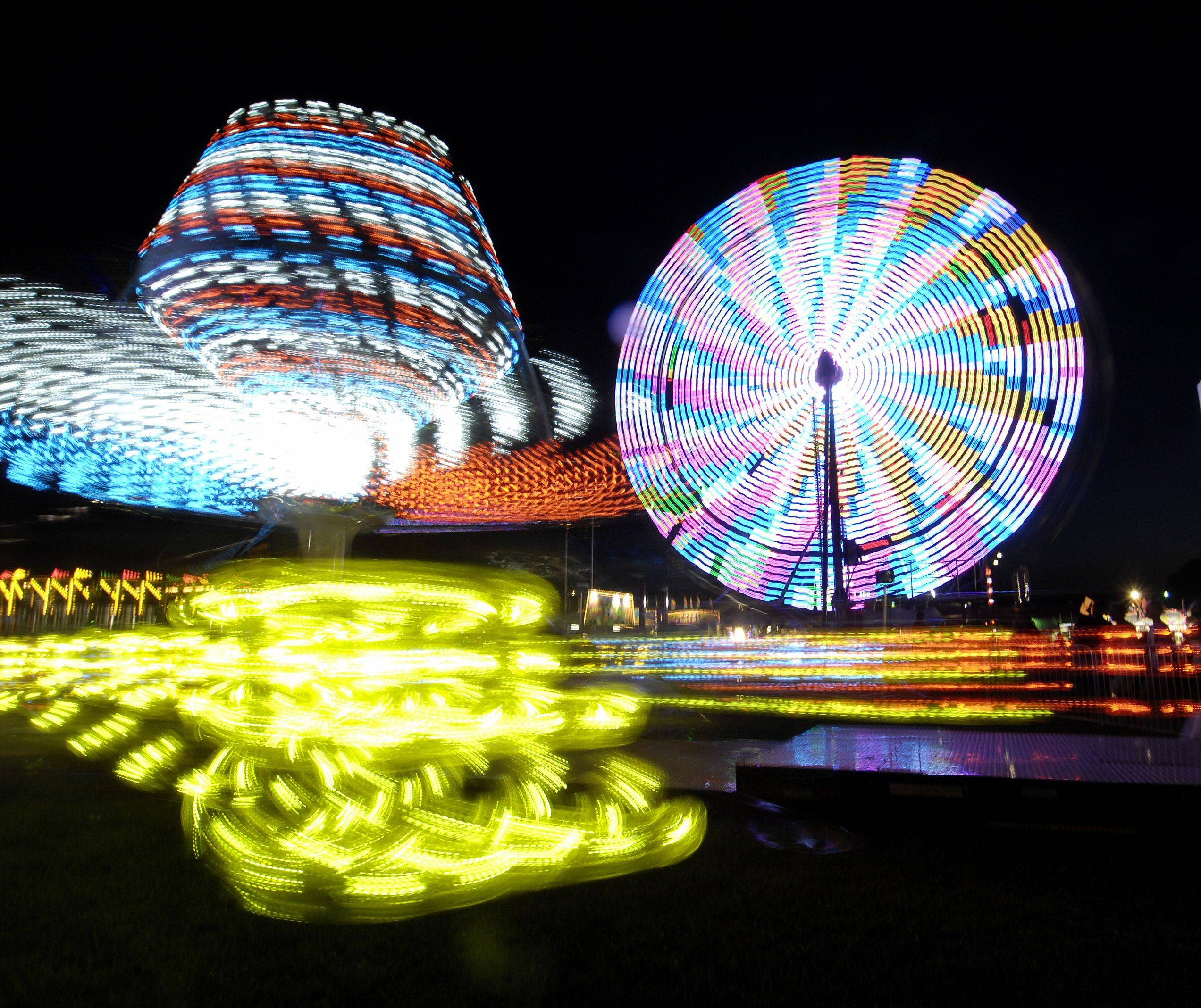 Carnival rides spin at last year's McHenry County Fair in Woodstock.