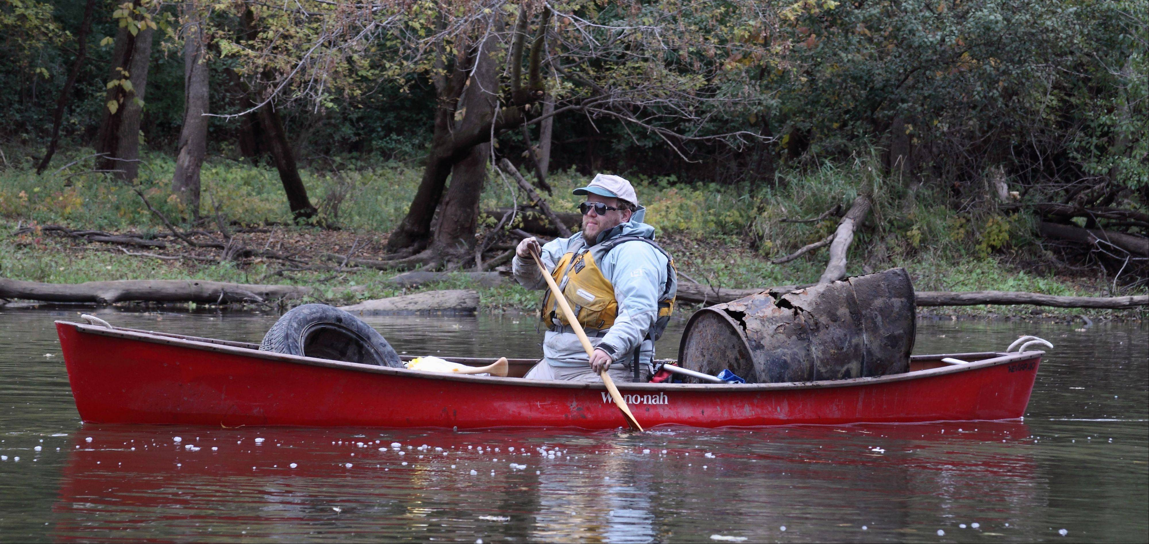 Tom Eckels with a canoe full of debris removed from the Des Plaines River.