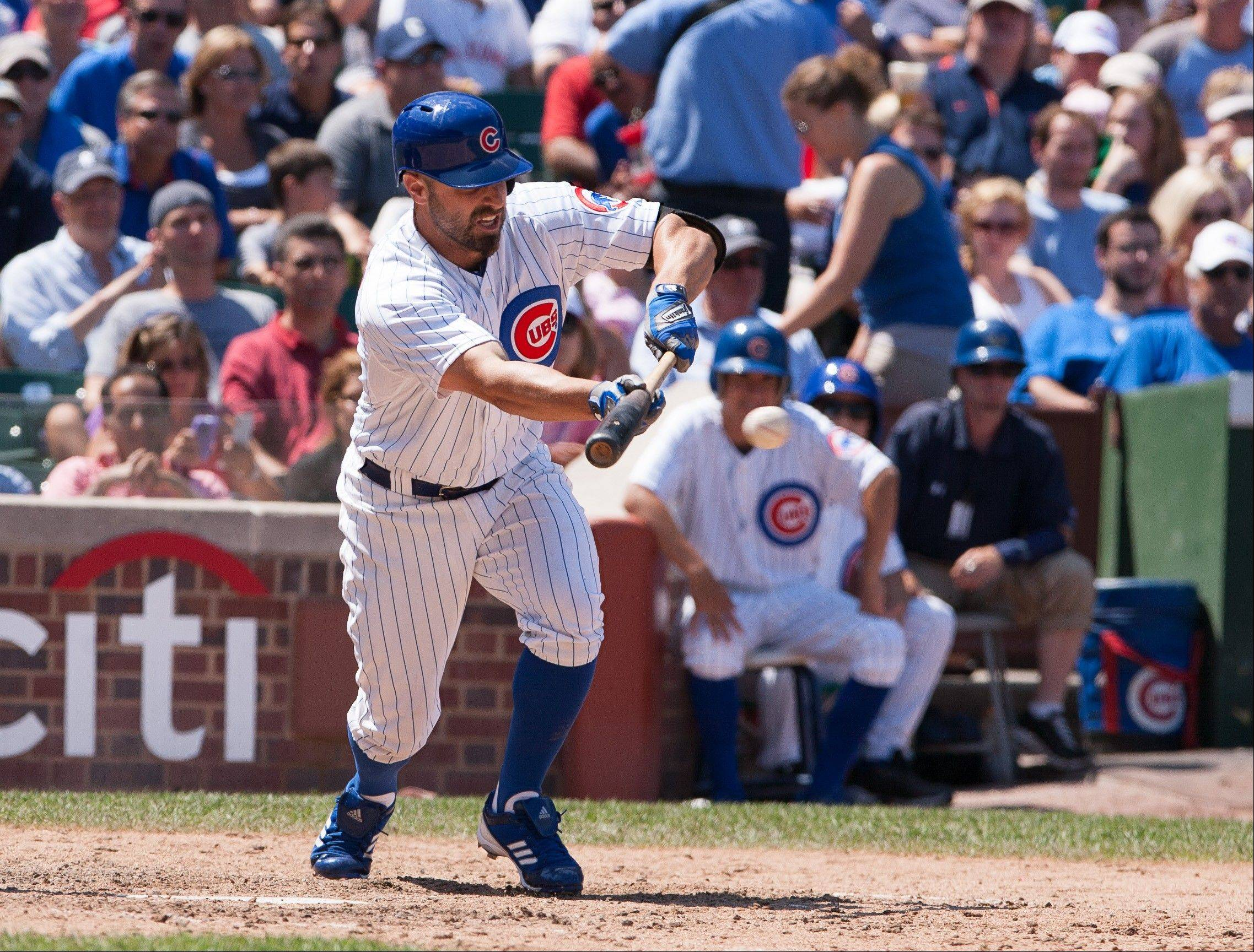 Reed Johnson puts down his RBI bunt single in the seventh inning Saturday at Wrigley Field to give the Cubs a 3-2 lead.