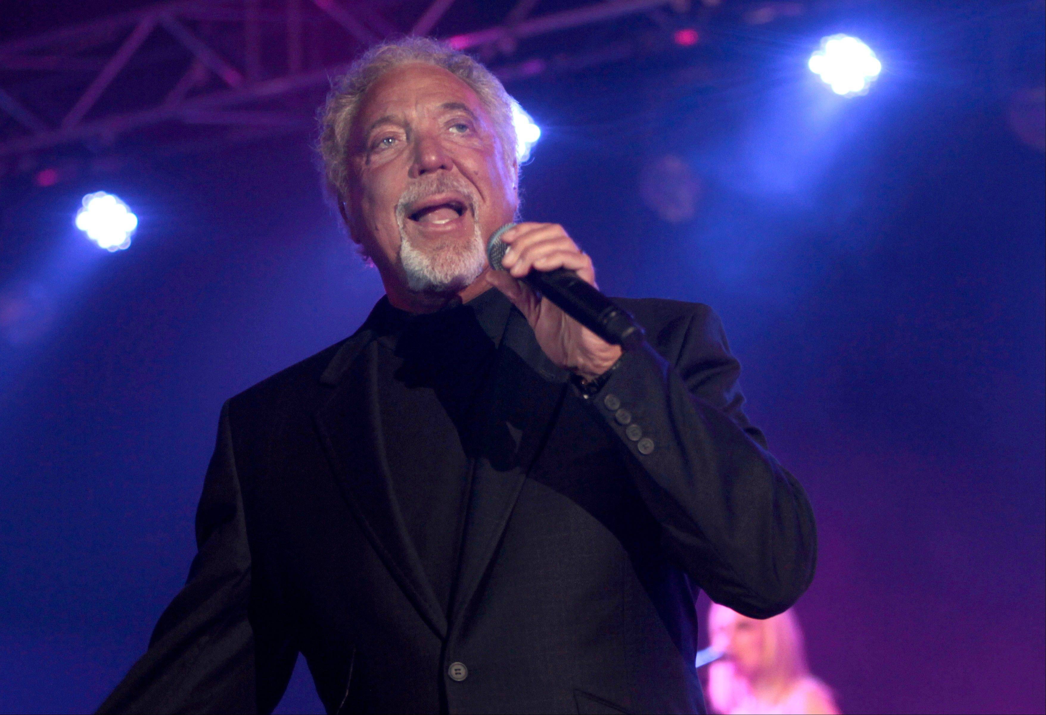 Singer Tom Jones performs during a concert in Beirut, Lebanon. Jones has apologized to fans after pulling out of an Olympic celebration concert in London after contracting bronchitis. The 72-year-old Welsh crooner had been due to entertain tens of thousands of people at the outdoor concert in Hyde Park on Saturday, July 28, 2012. He was replaced by British singer Will Young.