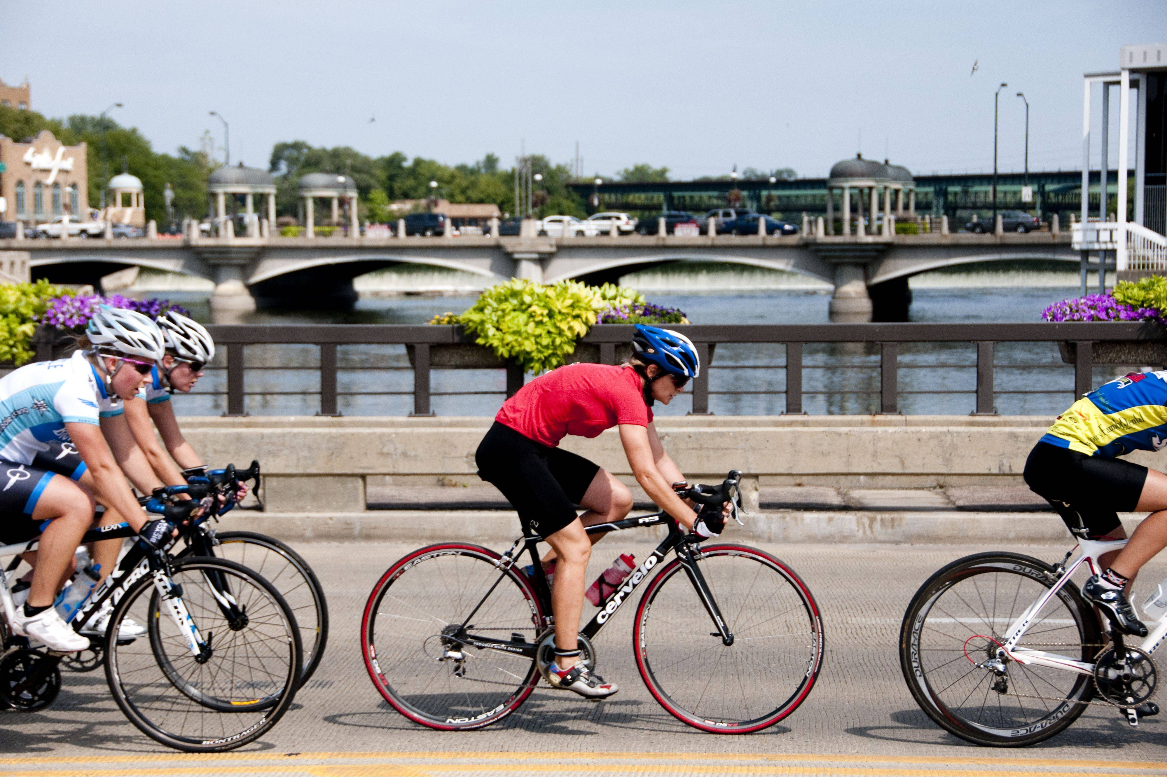 Competitors in the women�s category 3/4 of the Sammy�s St. Charles Prairie State Criterium race across the Fox River Sunday in downtown St. Charles. The race began and ended at Sammy�s Bike Shop using 1st Street, Illinois Avenue and Riverside Avenue as the course.