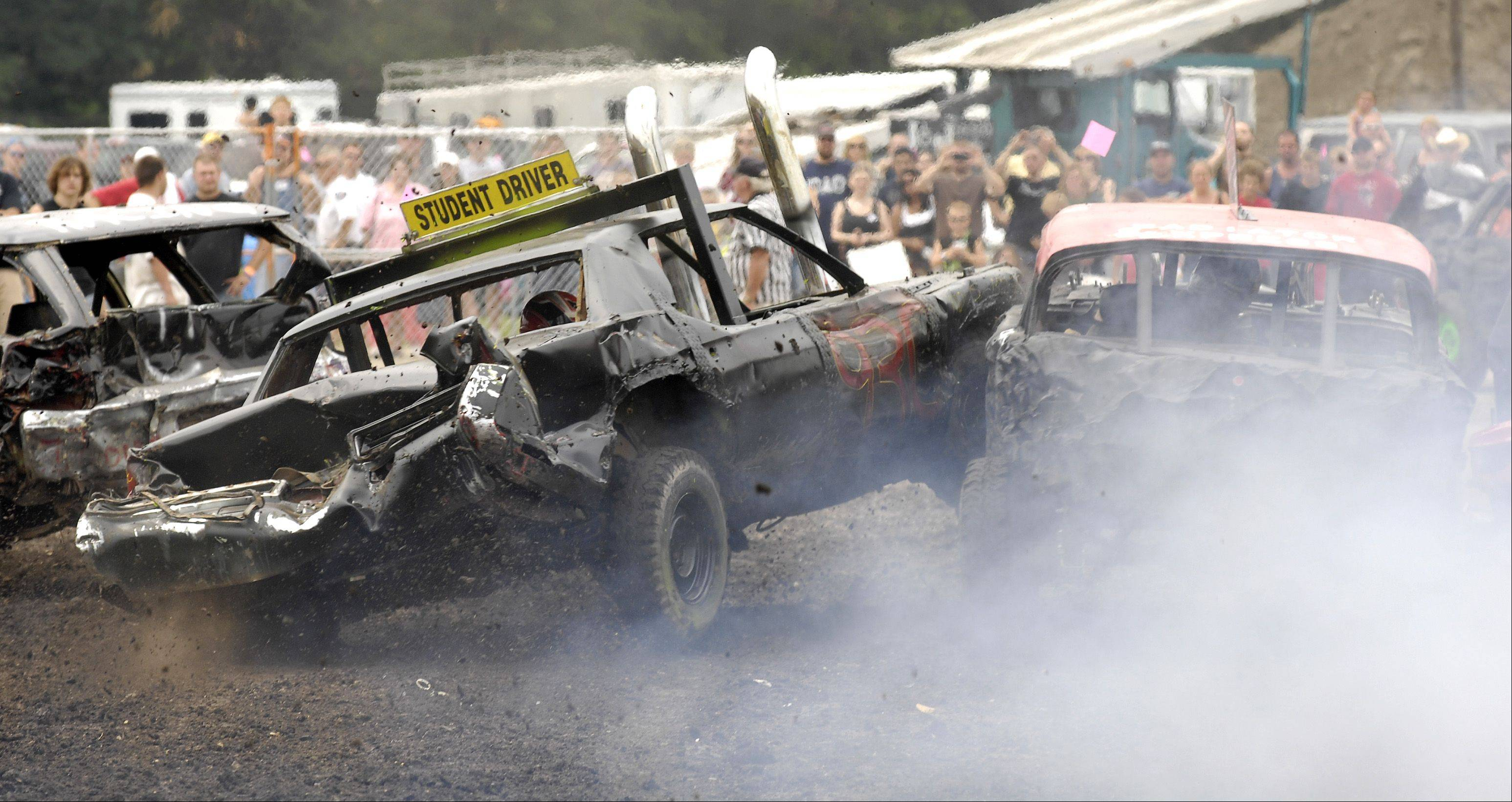Competitors hit each other hard during the demolition derby Sunday at the DuPage County Fair in Wheaton.