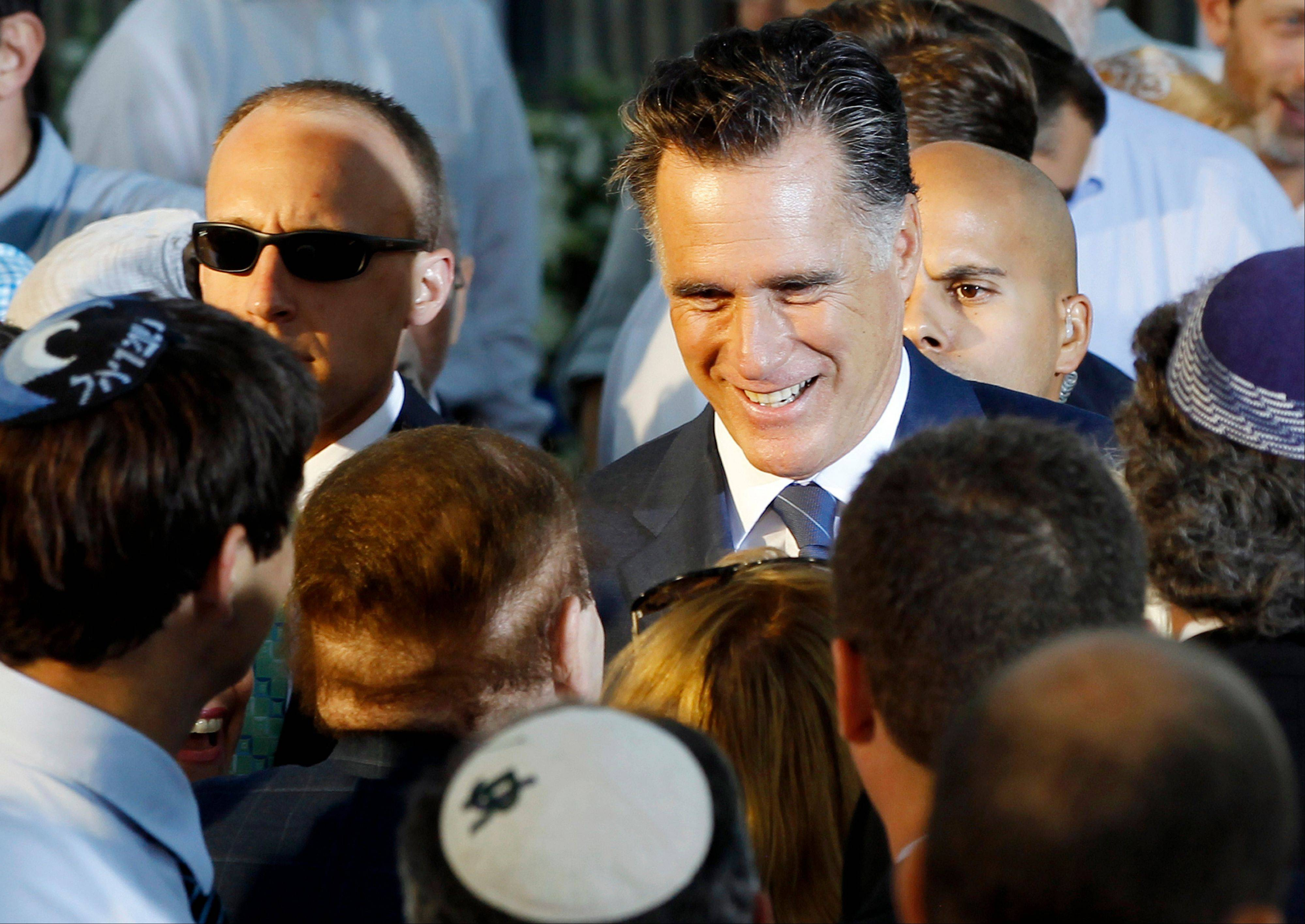Republican presidential candidate and former Massachusetts Gov. Mitt Romney talks to American businessman Sheldon Adelson, who has said he will donate millions to Romney�s campaign, after he delivered a speech in Jerusalem, Sunday.