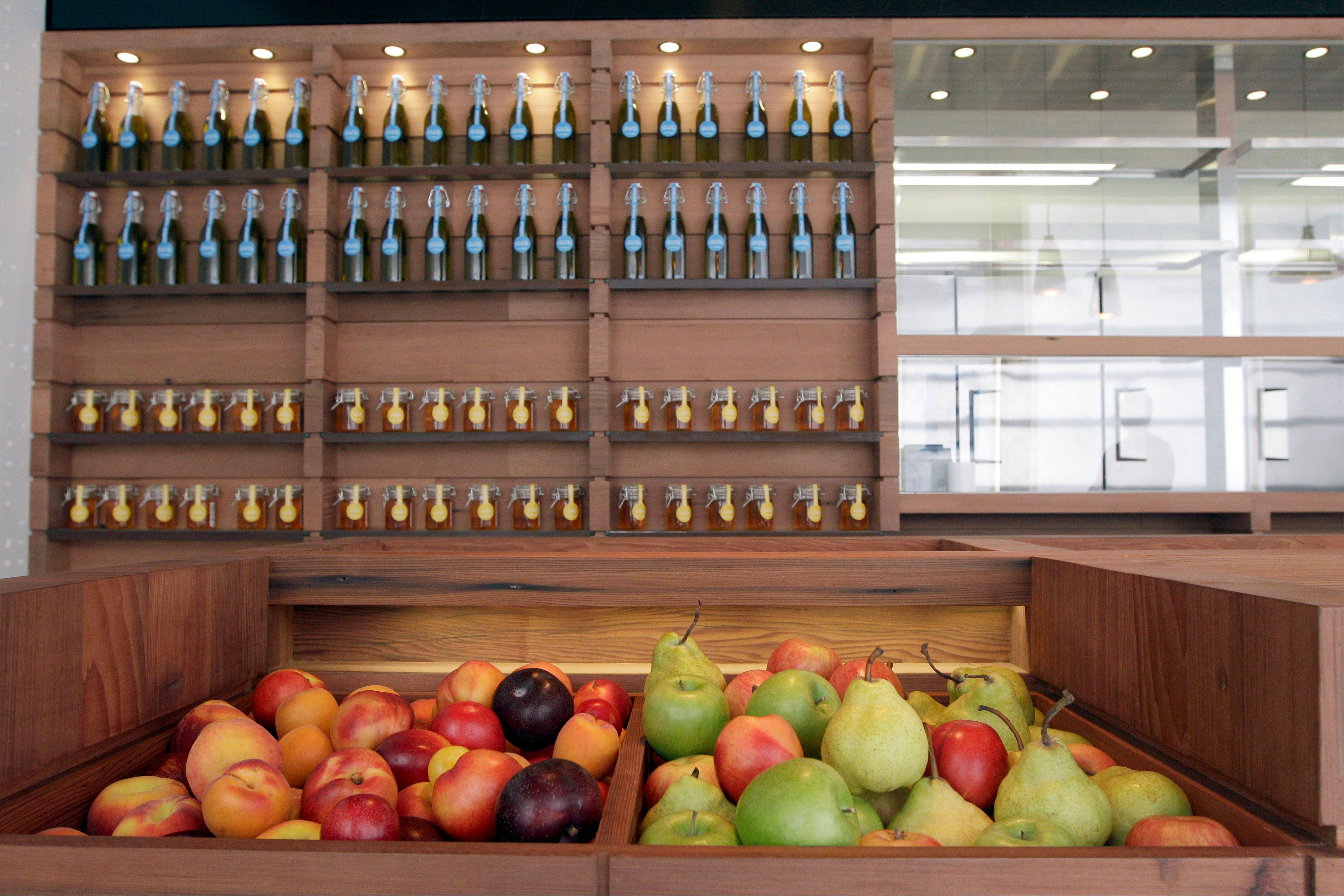 "Fresh fruit, New York clover honey and Greek olive oil are on display for sale at the Chobani yogurt bar in the Soho neighborhood of New York on July 23. Chobani, opened its first ""yogurt bar"" in New York City on Wednesday as it looks to strengthen its position in a rapidly growing market."