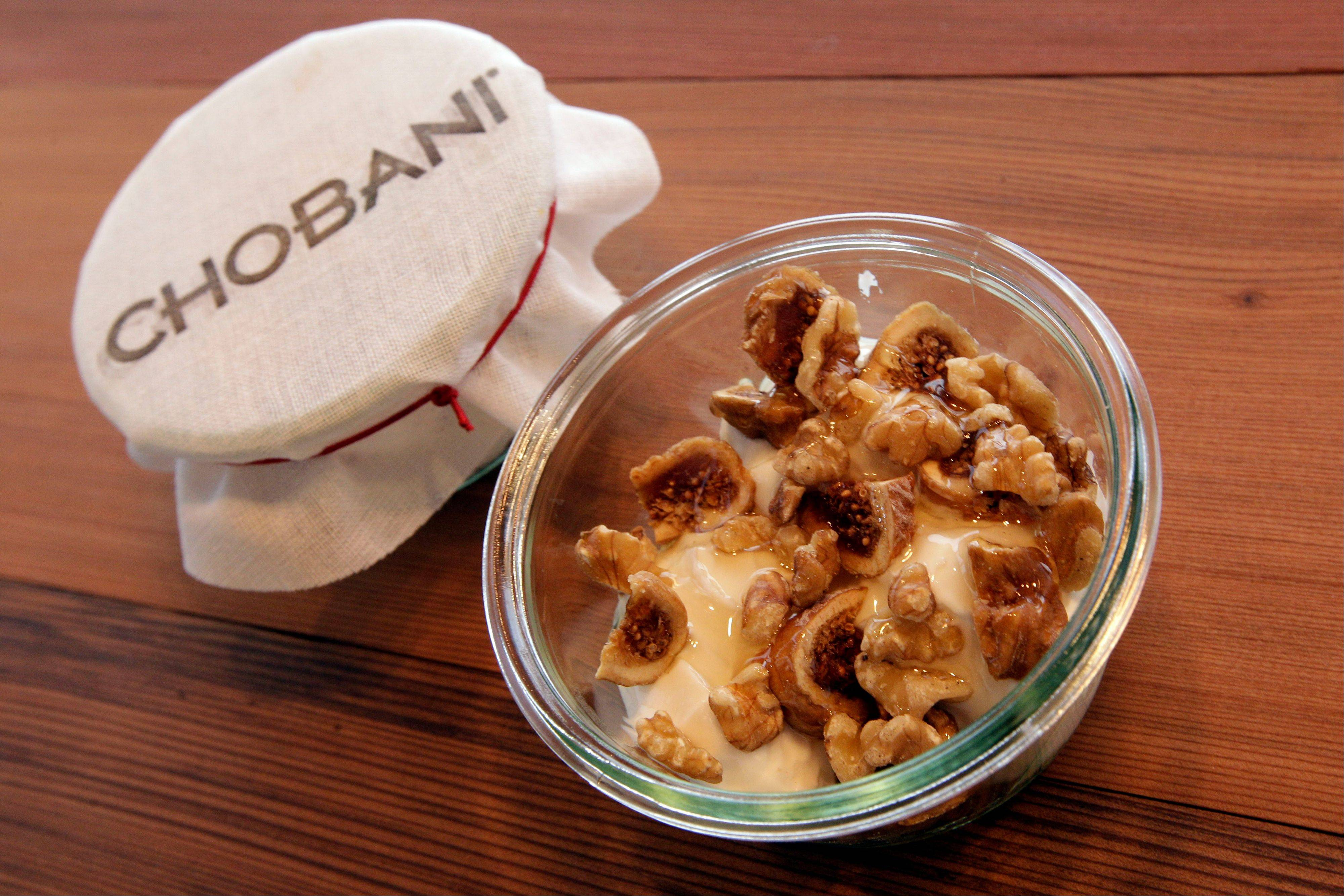 "A bowl of ""Fig + Walnut"" made with Turkish figs, walnuts, and honey is on display at the Chobani yogurt bar in the Soho neighborhood of New York on July 23. Chobani, opened its first ""yogurt bar"" in New York City on Wednesday as it looks to strengthen its position in a rapidly growing market."