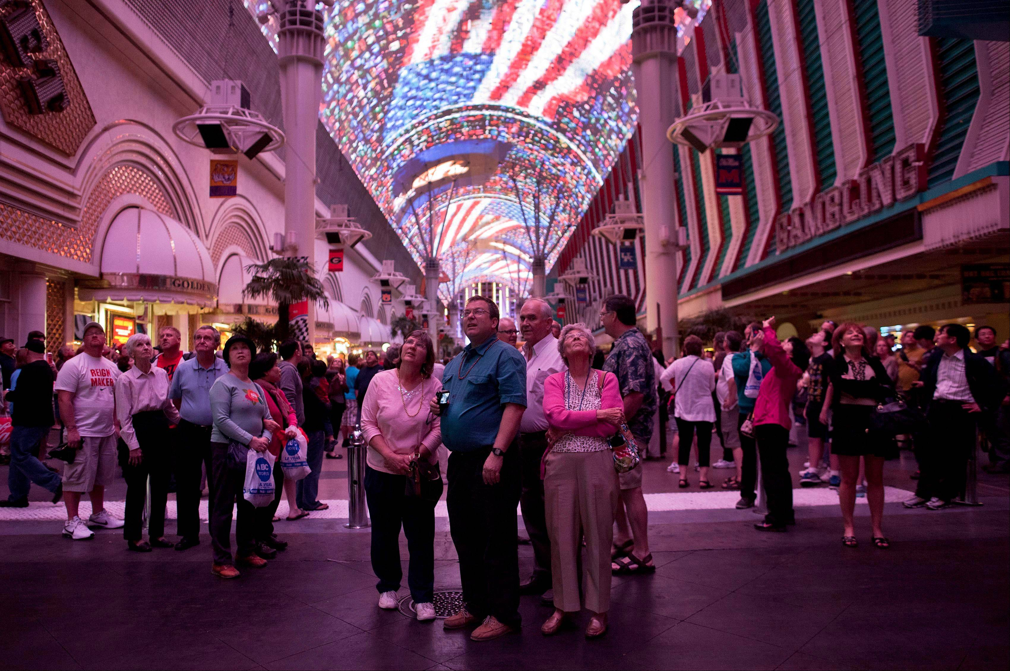 Tourists stop to watch the canopy light show at the Fremont Street Experience in Las Vegas on March 22. Despite some recent diversification, Nevada's economy is more concentrated than virtually any other state. The tourism/gambling sector accounts for more than one-quarter of Nevada's 1.14 million nonfarm jobs, and 13 of the 20 largest employers are casino/hotel companies. Obama and his Republican rival, Mitt Romney, have visited the state, competing strenuously for Nevada's six electoral votes in what has become one of the most intense swing-state contests.