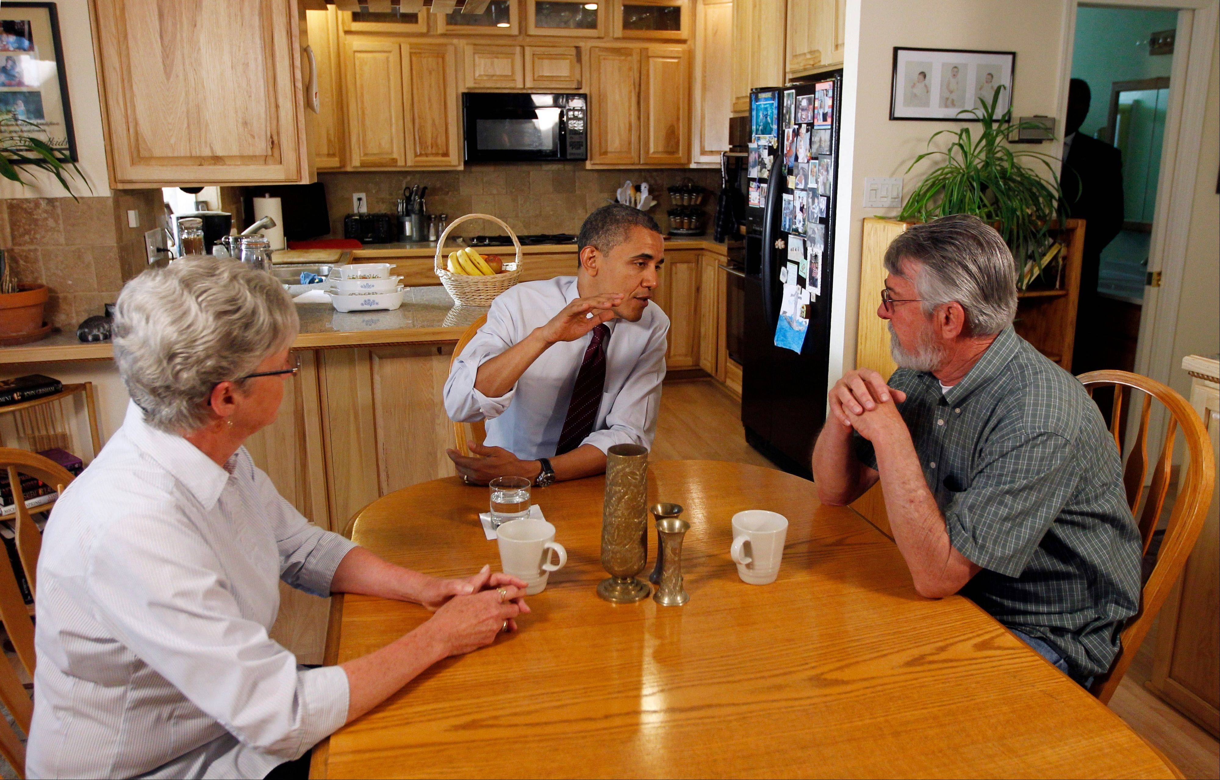 President Barack Obama meets with Val and Paul Keller in their home in Reno, Nev., on May 11. Obama and his Republican rival, Mitt Romney, have visited the state, competing strenuously for Nevada's six electoral votes in what has become one of the most intense swing-state contests.