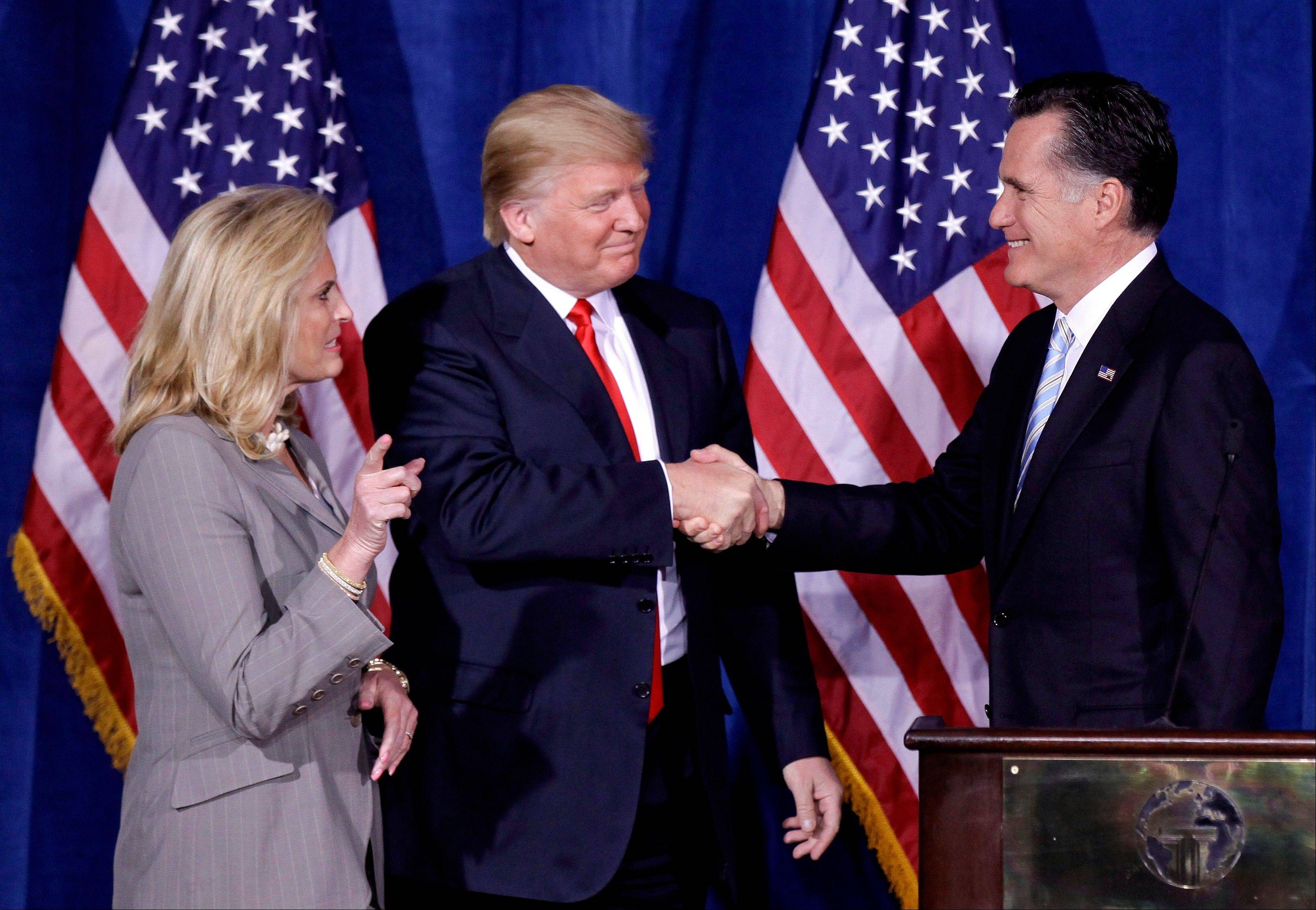Donald Trump greets Republican presidential candidate Mitt Romney on Feb. 2 after announcing his endorsement of Romney during a news conference in Las Vegas. President Barack Obama and Romney have visited the state, competing strenuously for Nevada's six electoral votes in what has become one of the most intense swing-state contests. Romney's wife, Ann, is at left.