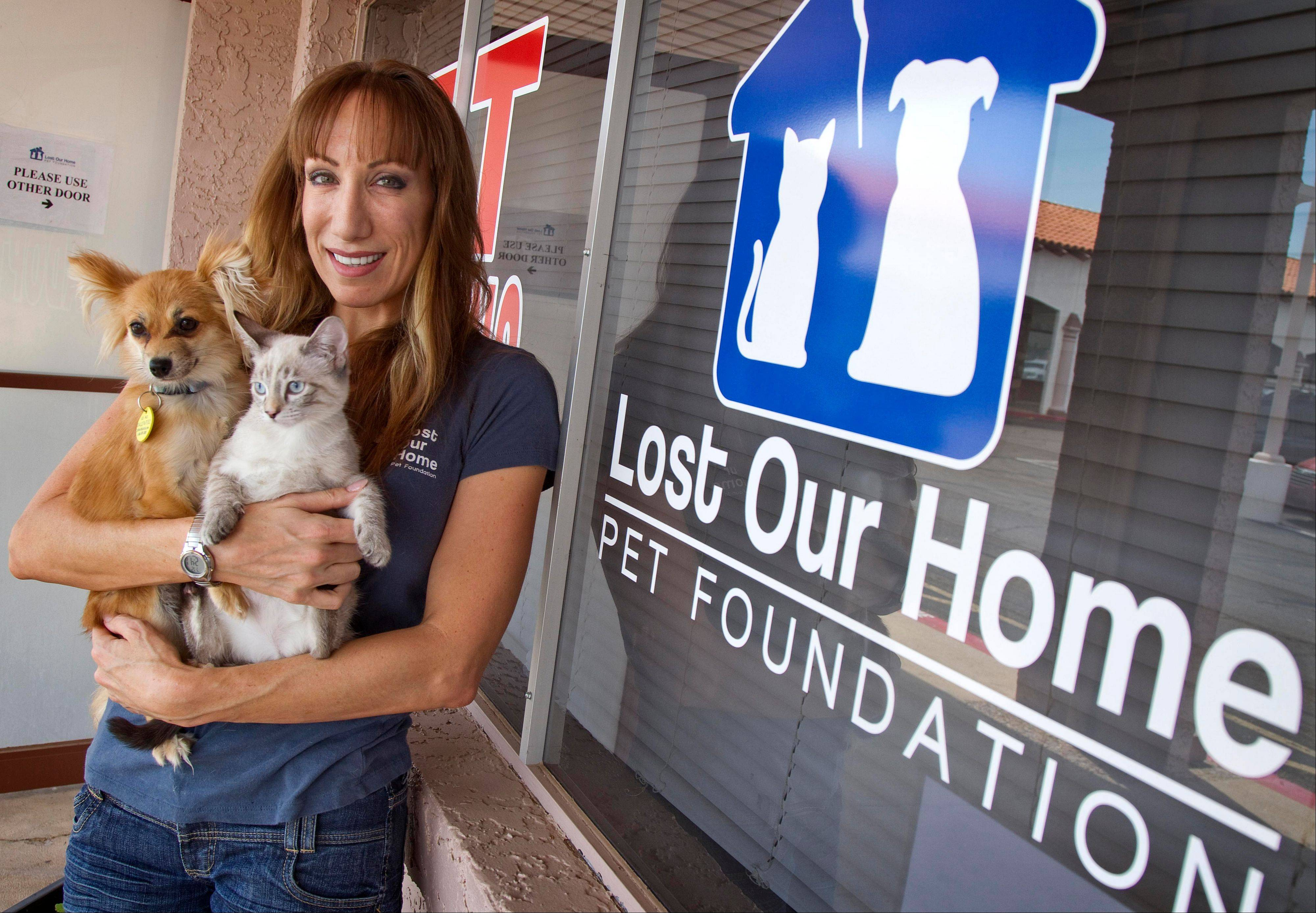 Jodi Polanski, founder and executive director of Lost Our Home Pet Foundation, stands outside her business in Phoenix. Lost Our Home helps people facing foreclosure place their pets with other families or in foster environments until their owners can get them back. Lost Our Home Pet Foundation rescue and food bank relies primarily on fosters although it did open a small shelter in April. It has 35 to 40 animals in the shelter and 220 in foster homes and has placed over 2,000 animals in four years.