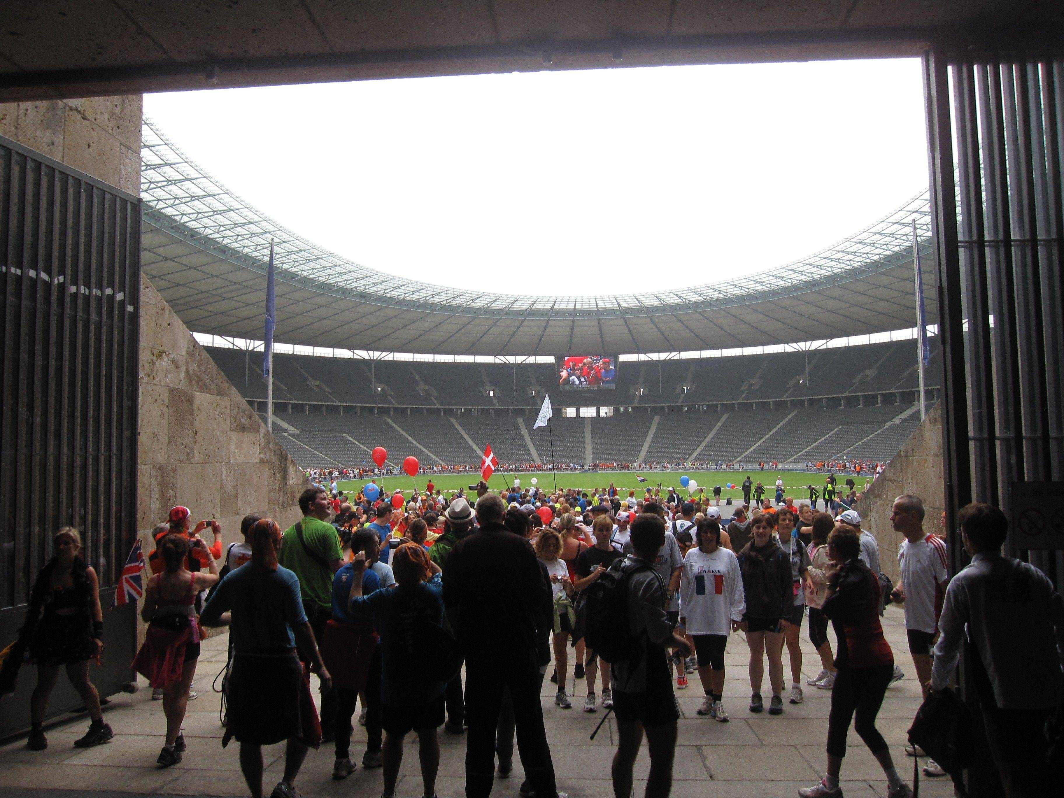 People visit the tunnel used by runners to finish the marathon during the 1936 Berlin Games during a fun run the day before the Berlin Marathon in Berlin.