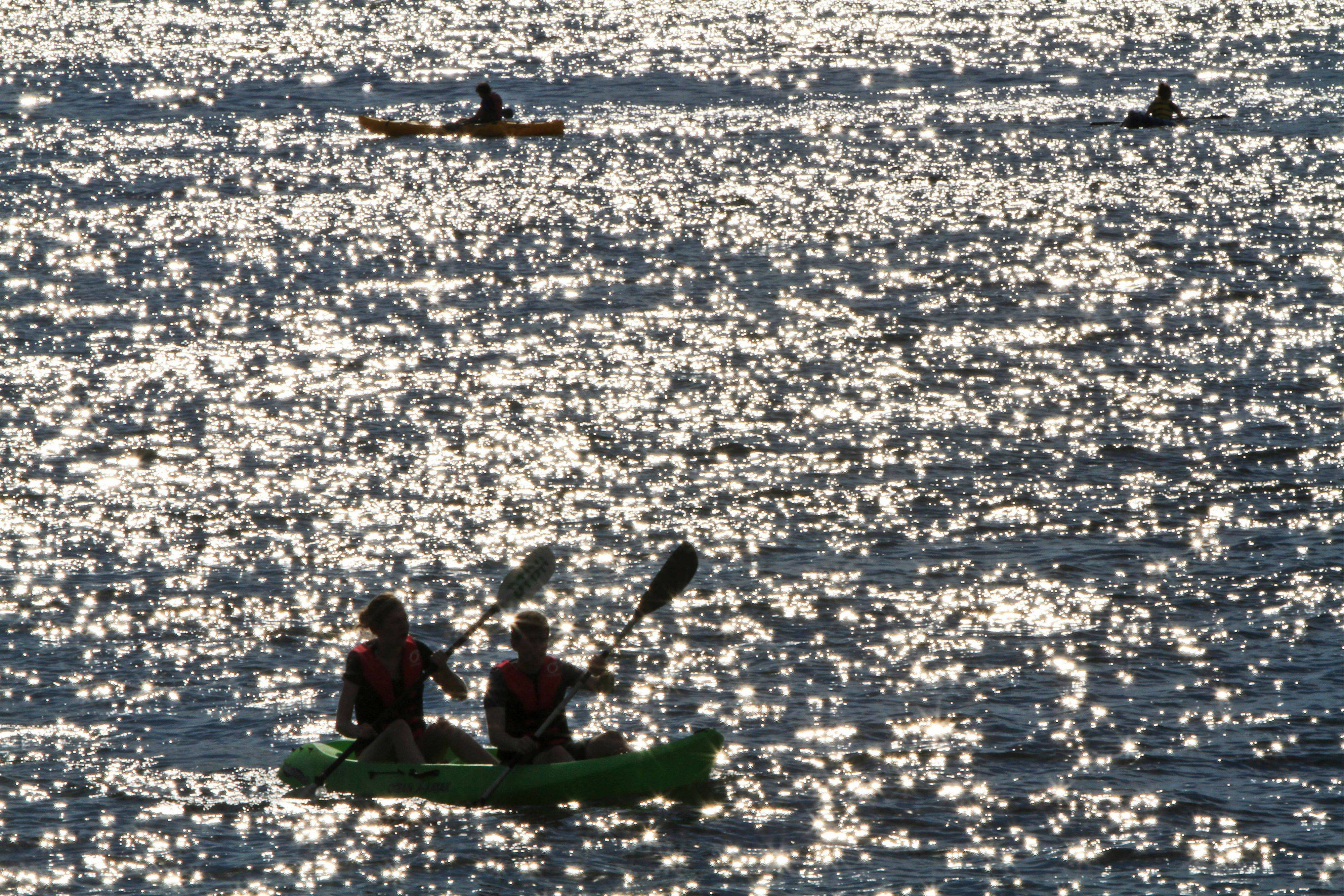 Kayakers paddle in the Hudson River along Hudson River Park.