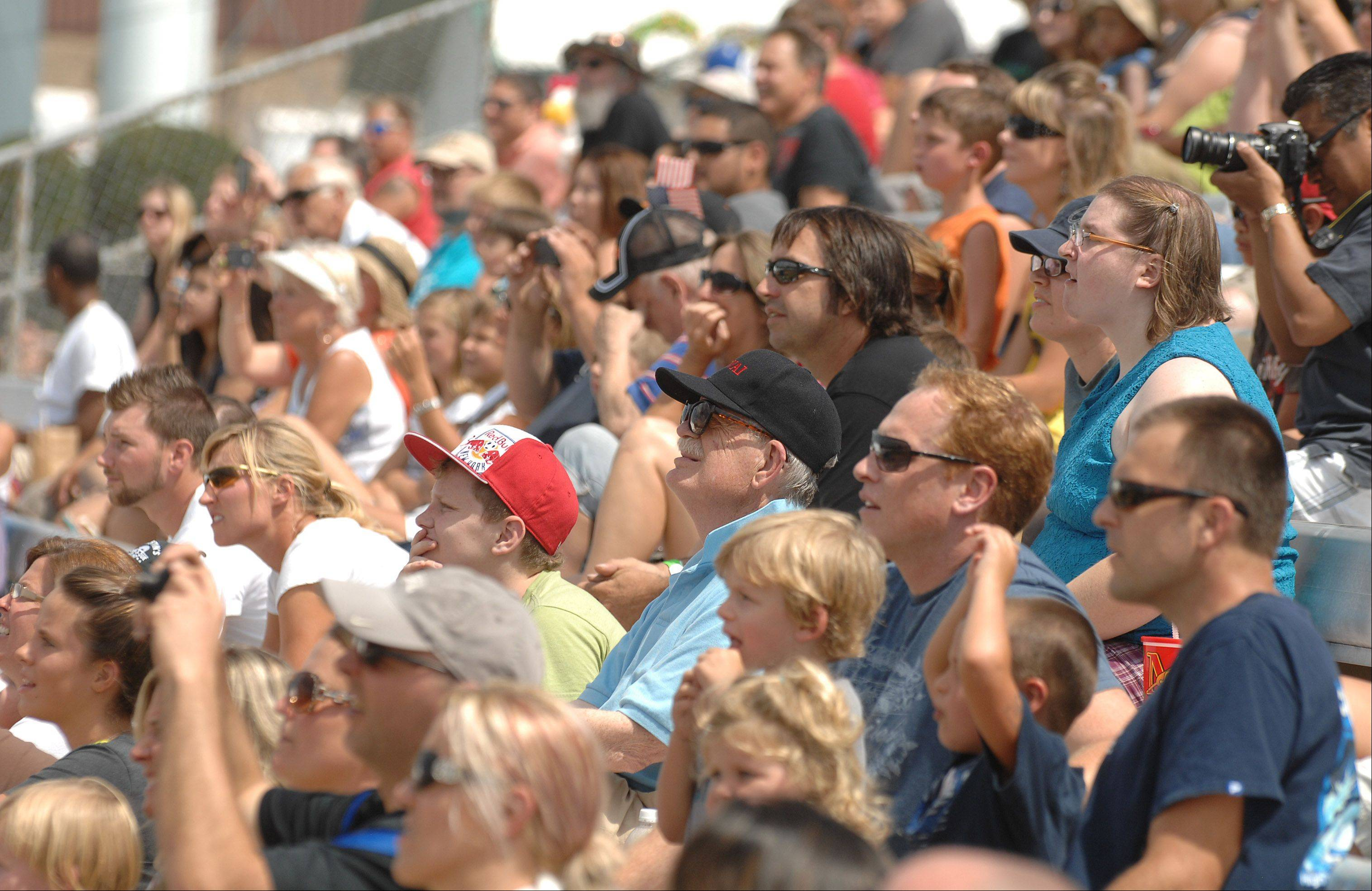 Fans keep an eye to the sky Saturday during the U.S. FMX Championship Series motocross contest at the DuPage County Fair in Wheaton. Three local judges gave riders scores based on crowd applause.